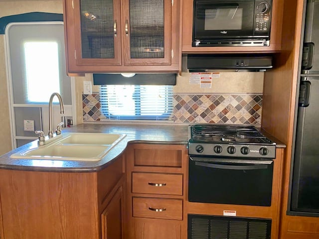 Kitchen has microwave, oven, 3 burner stove, fridge and freezer. Forest River Other 2015