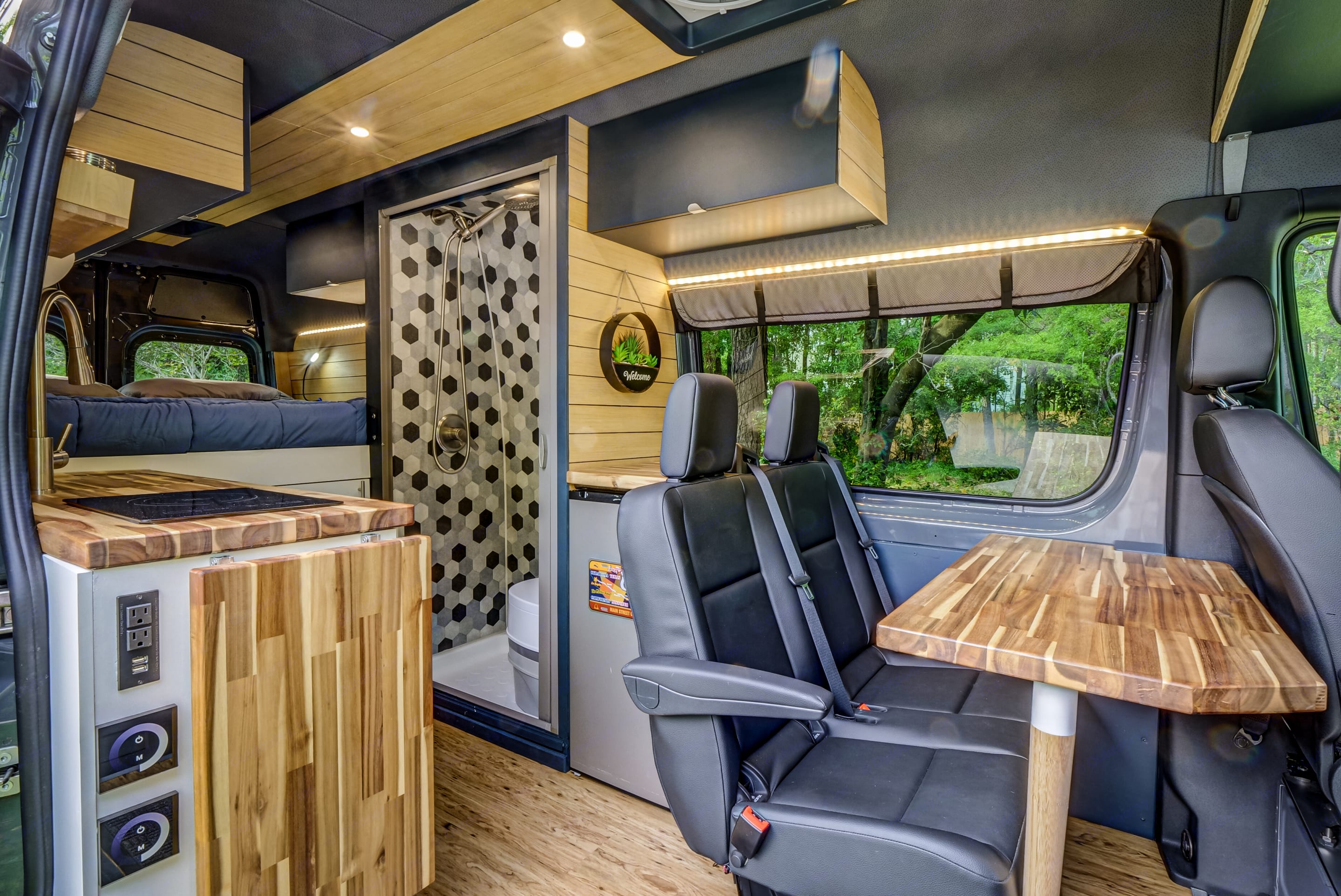 Seats swivel to allow 4 people to eat comfortably at the table.  When not used the table can be stored easily behind the seat.. Mercedes-Benz Sprinter 2020