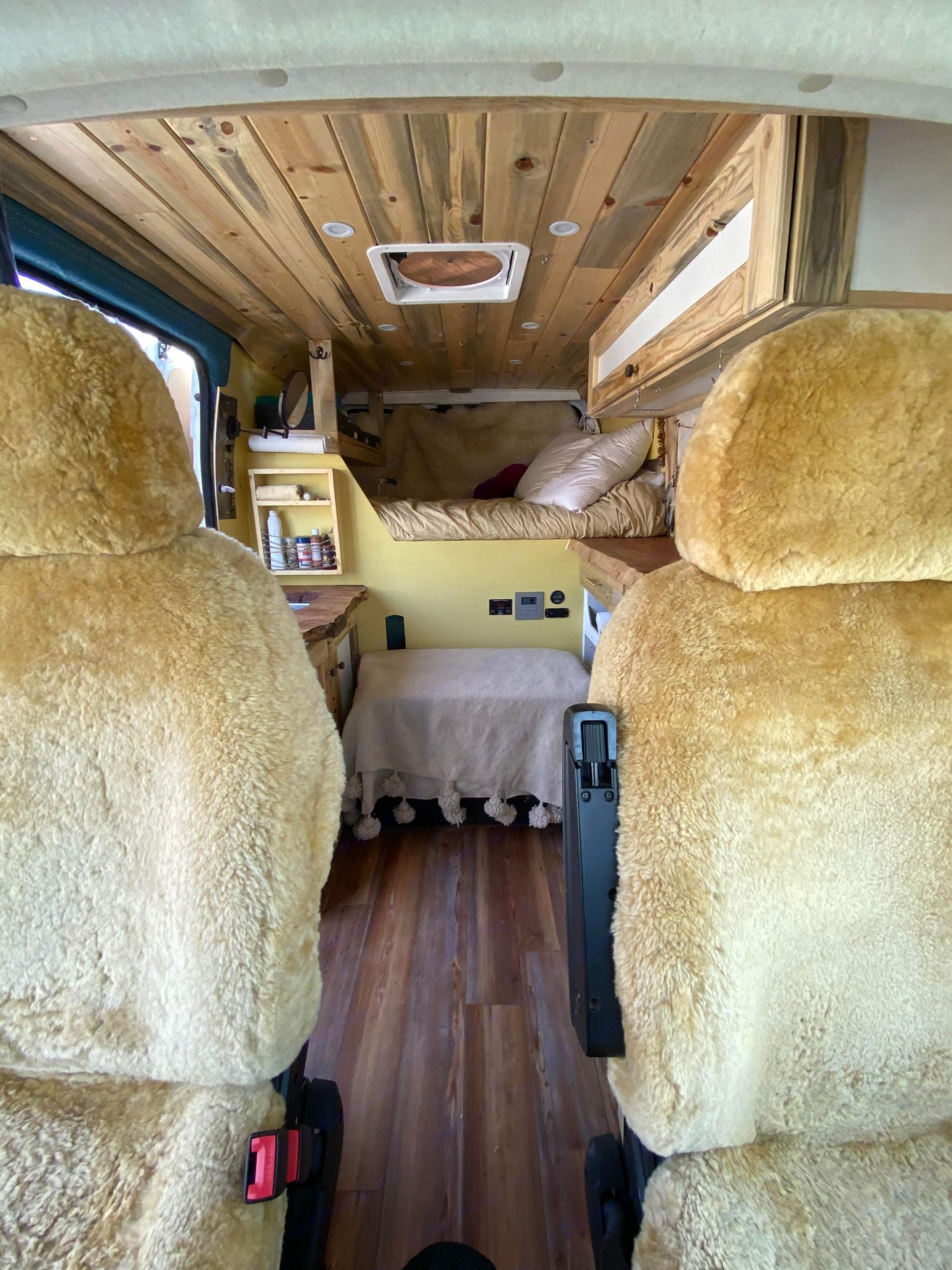 Super comfy cush, sheep skin seat covers. Passenger seat swivels out to create a living lounge space on the road.. Dodge Other 2019
