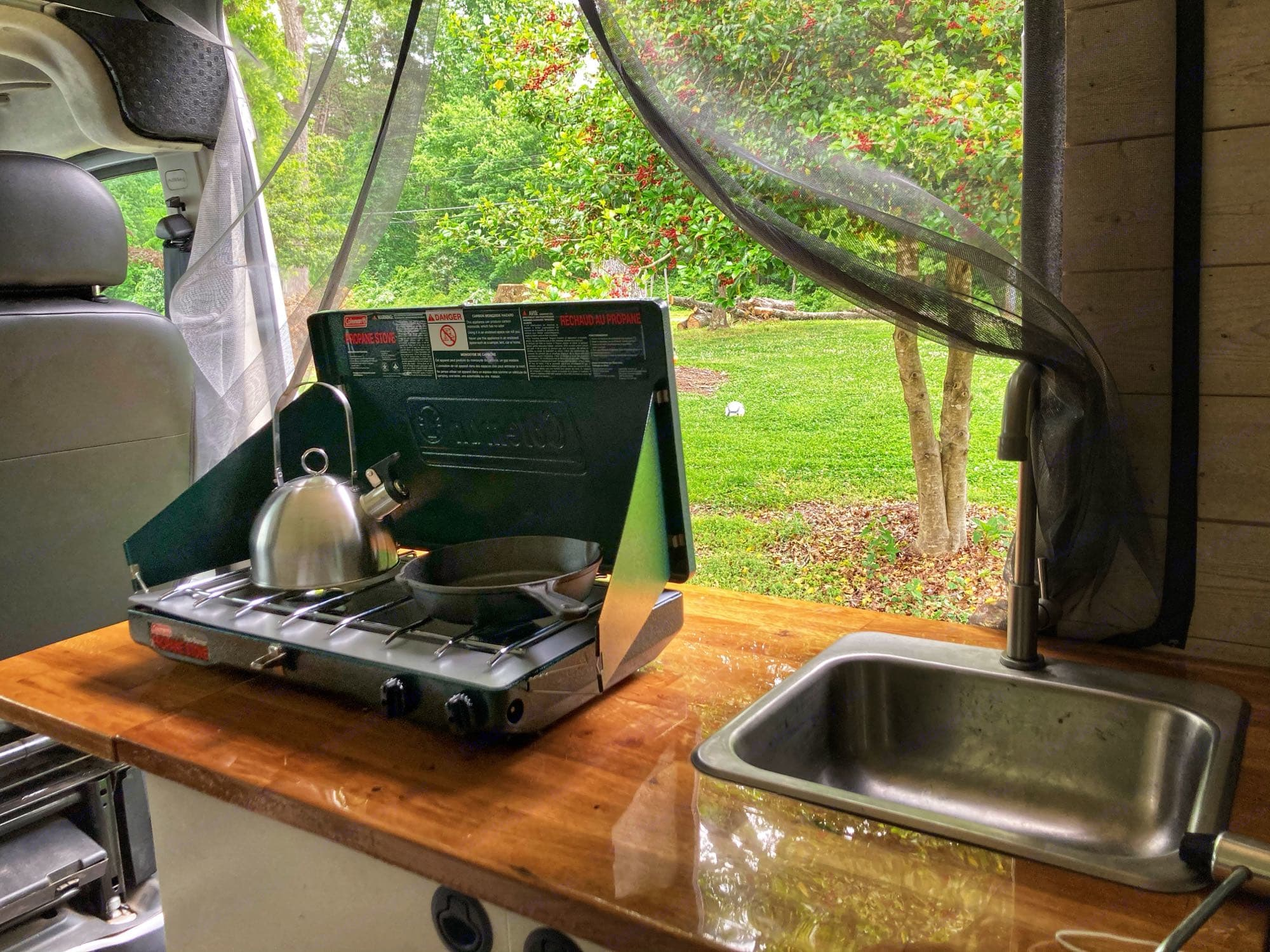 Great little countertop space to cook inside or move the propane camping stove outside. Your choice! Pump powered sink with 5 gallon tank.. Dodge Other 2018