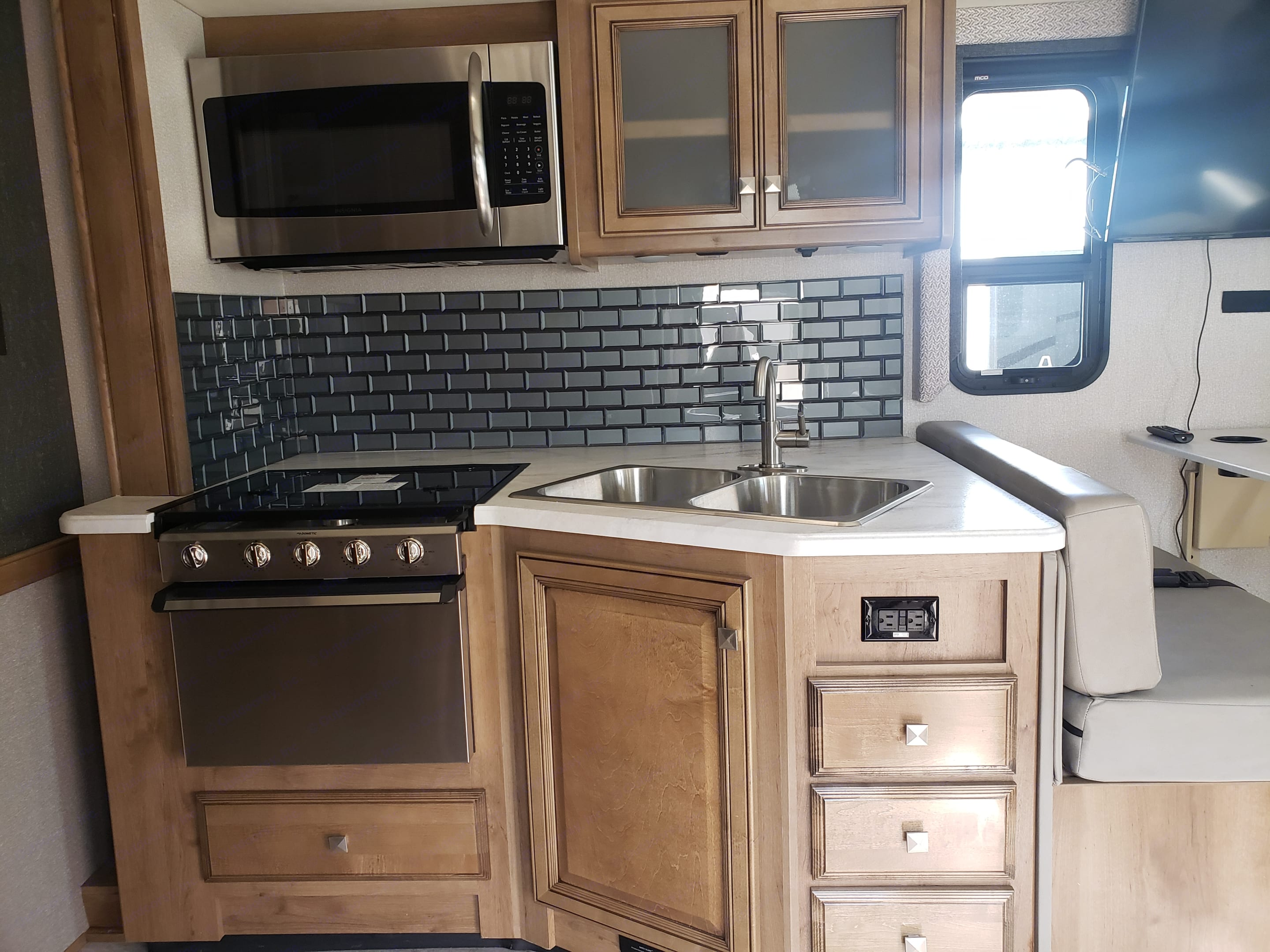 Kitchen stove microwave sink cupboards. Holiday Rambler Admiral 2021