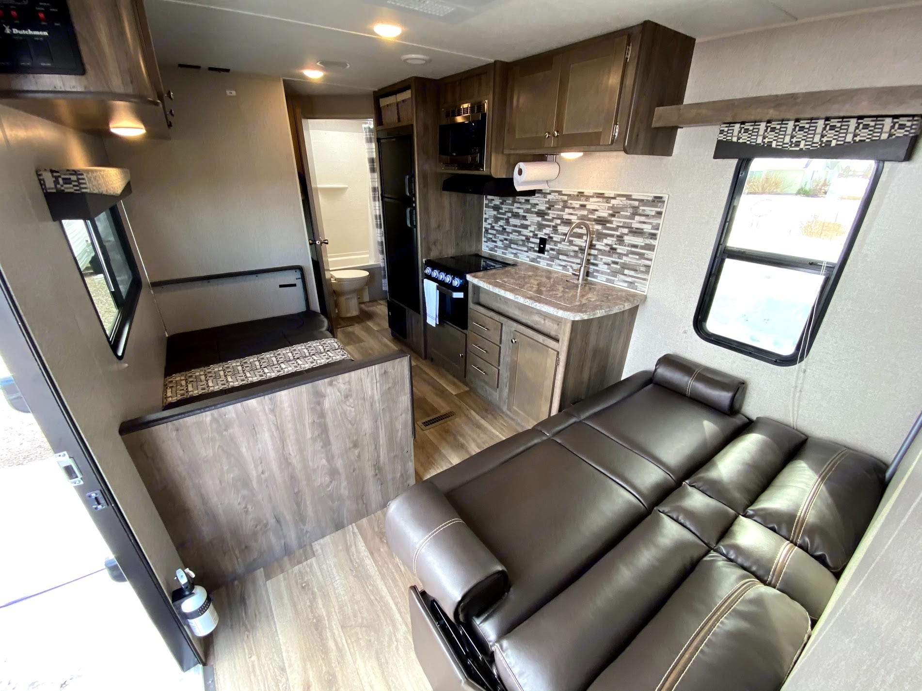 The Dutchmen has a comfortable living space with a couch and table (both fold into a bed), a fully equipped kitchen, and plenty of storage space. . Dutchmen Aspen Trail 2019