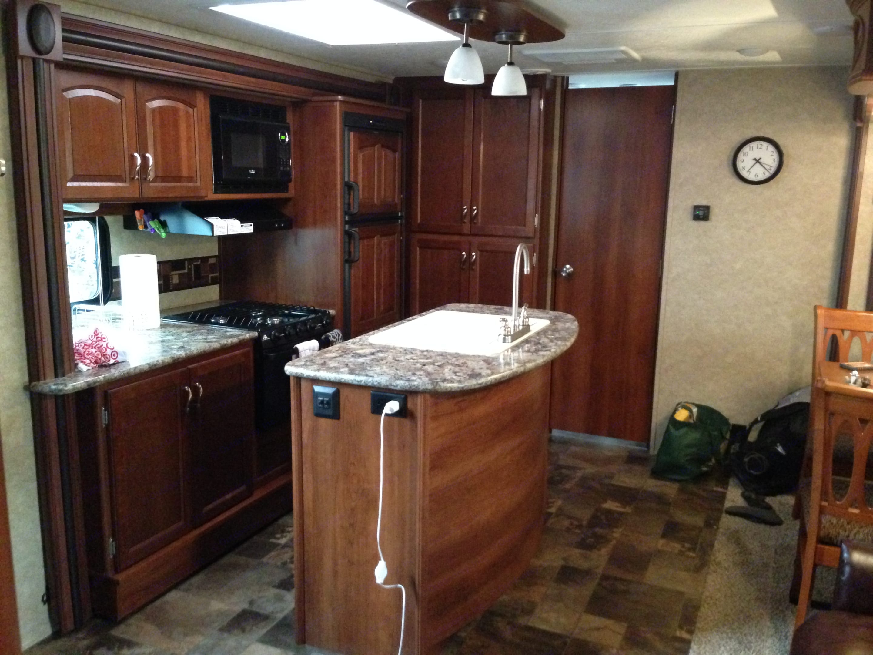 Great Island with board to cover sink and provide great counter space.  Trash can under sink.. Forest River Tracer 2014