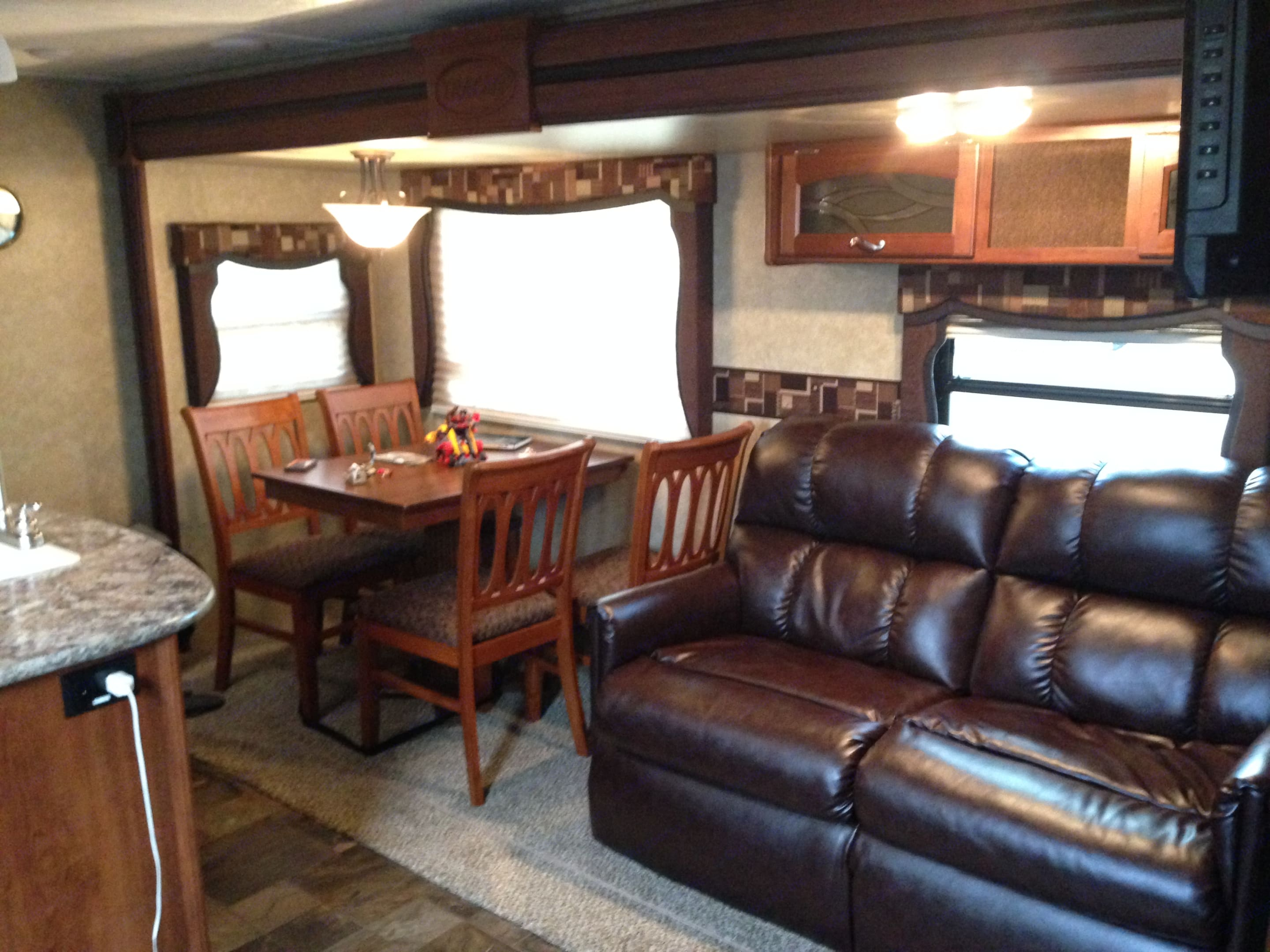 Comfortable sofa and great free standing table. Forest River Tracer 2014
