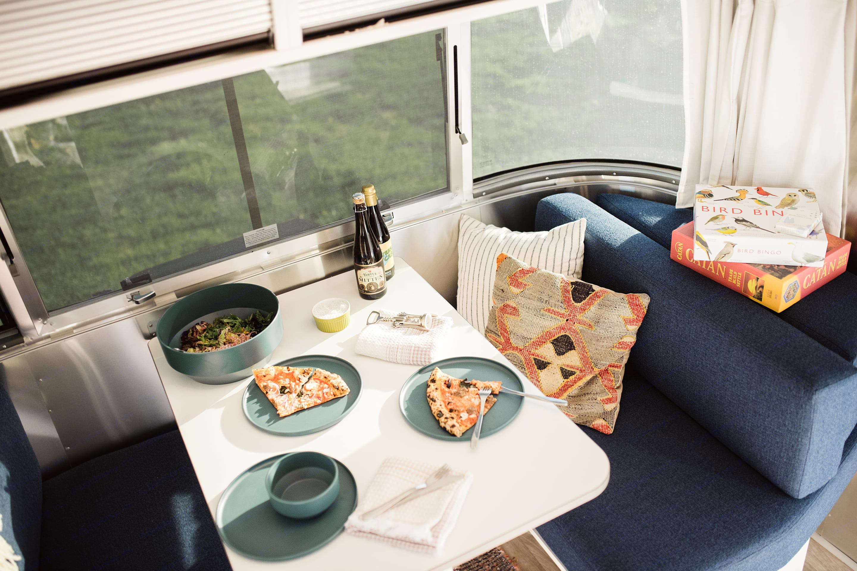 Seat 4 at the kitchen table and take in the scenery. . Airstream Bambi 19CB 2021
