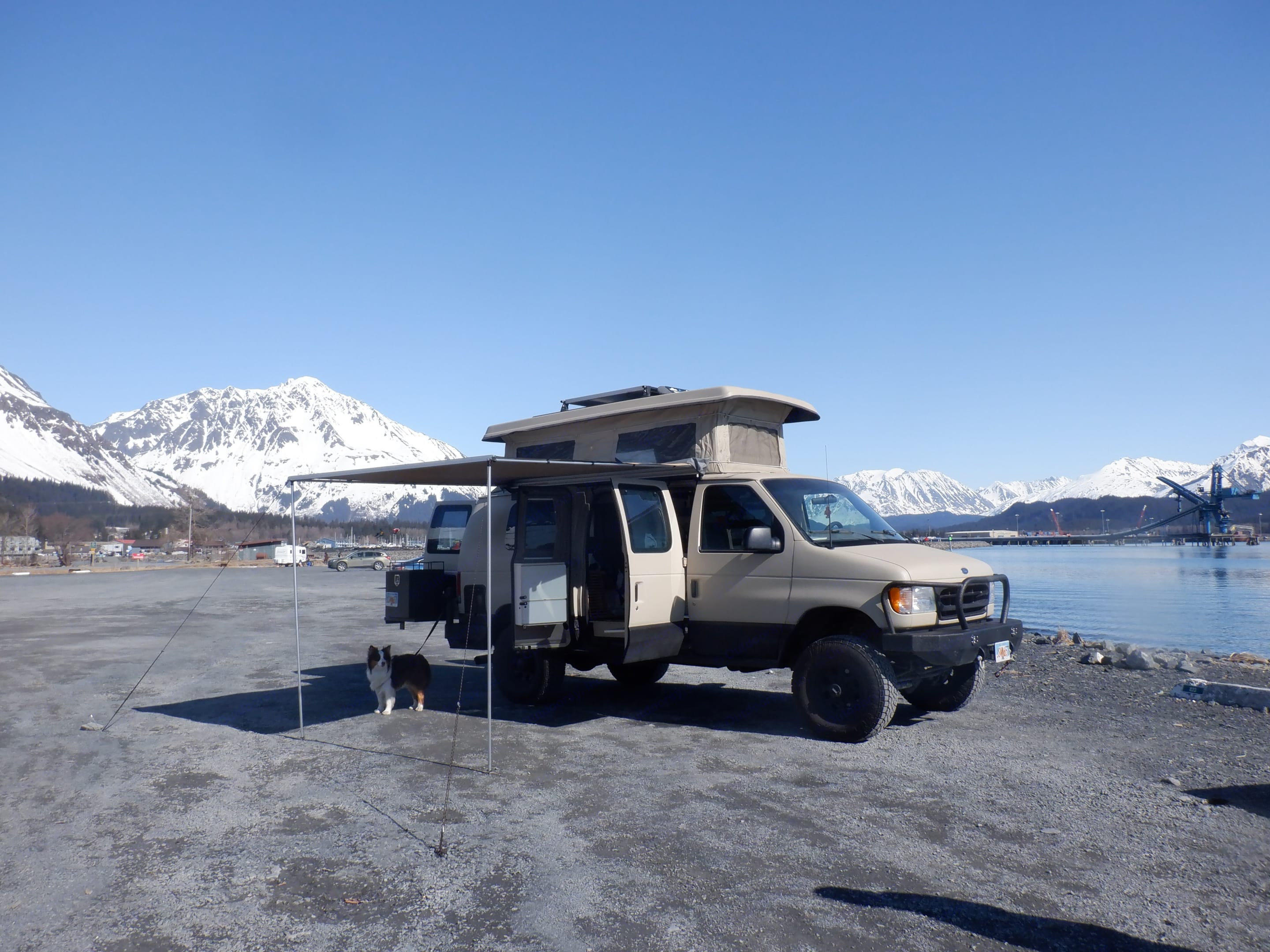 The pop-up and awning are great for beach camping. . Ford Ford E350 2002