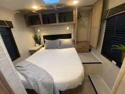 A walk-around Queen bed. Charging ports for your devices. Plenty of storage!. Jayco Redhawk 2021