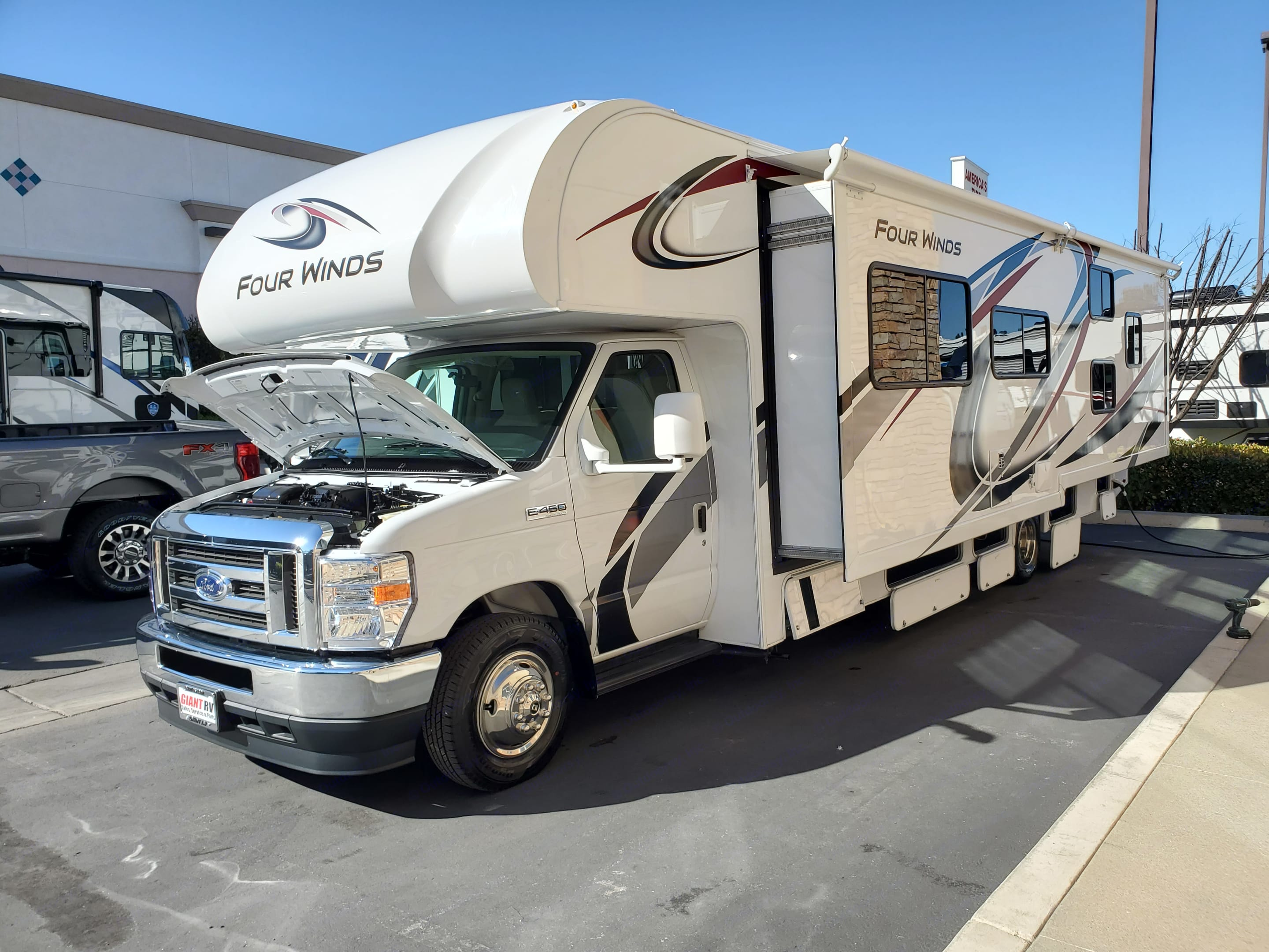You will love this massive slide out. Thor Motor Coach Four Winds 2021