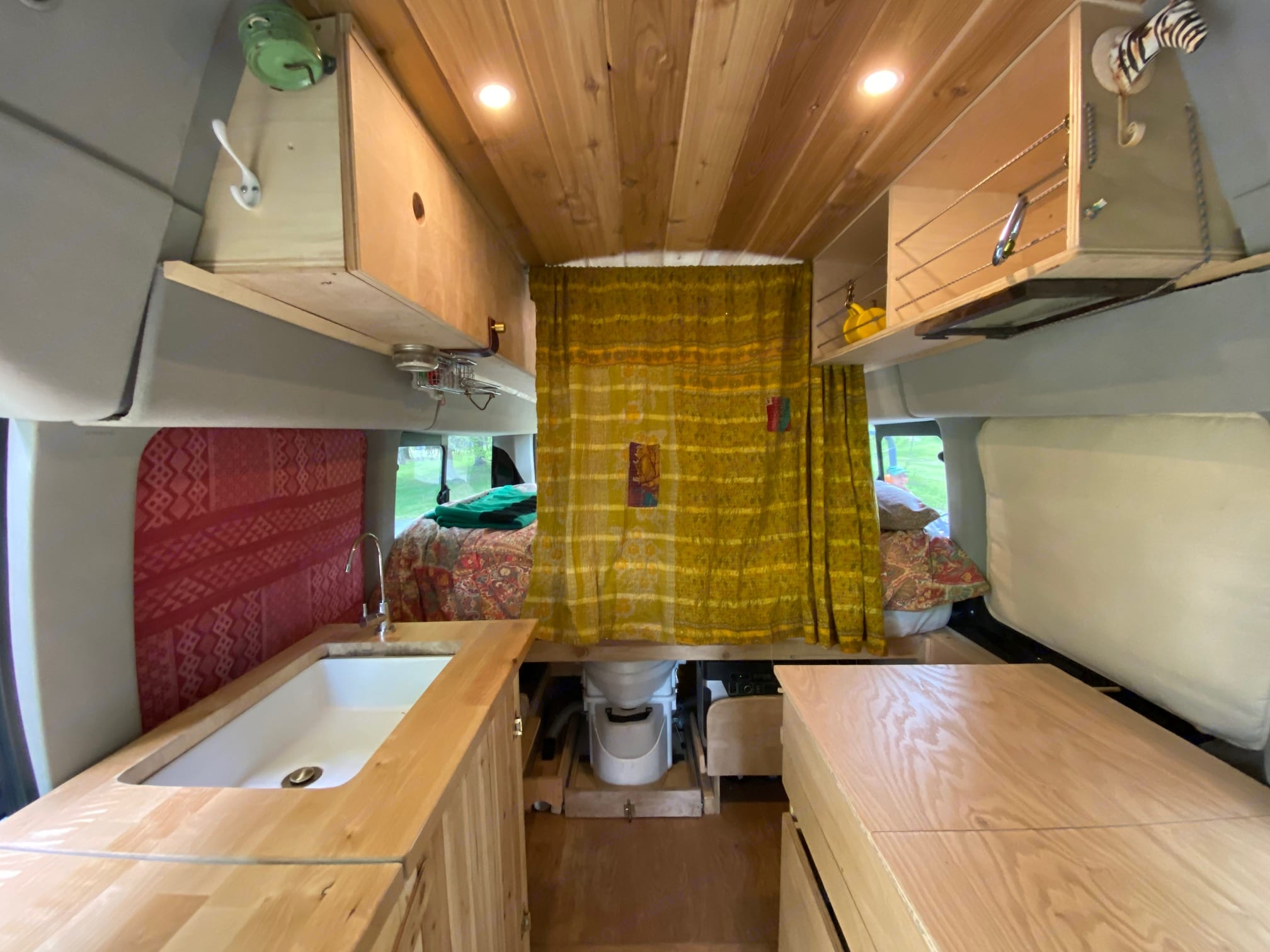 A curtain separates the main sleeping section. Ford Transit custom 2015