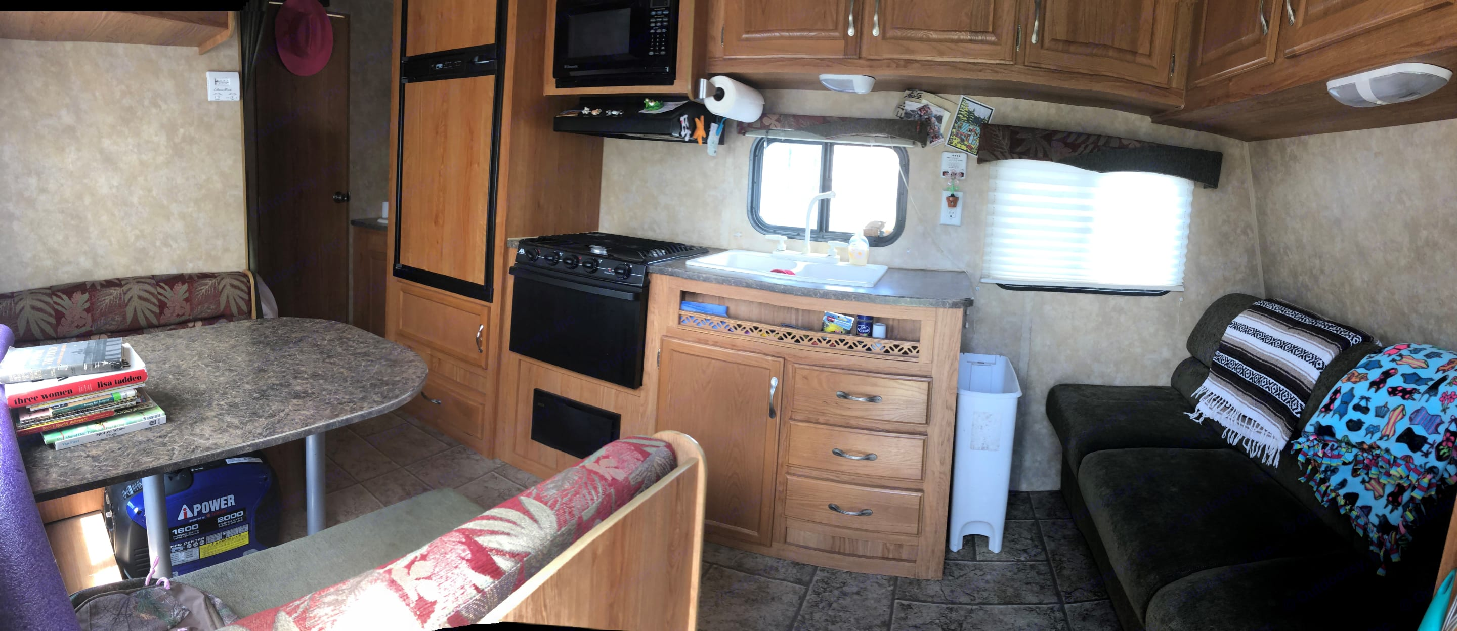 Entry way to the camper w/ the couch on the right and dinette on the left. Bath and full bed/twin bunk in the back. Jayco Jay Flight 2010