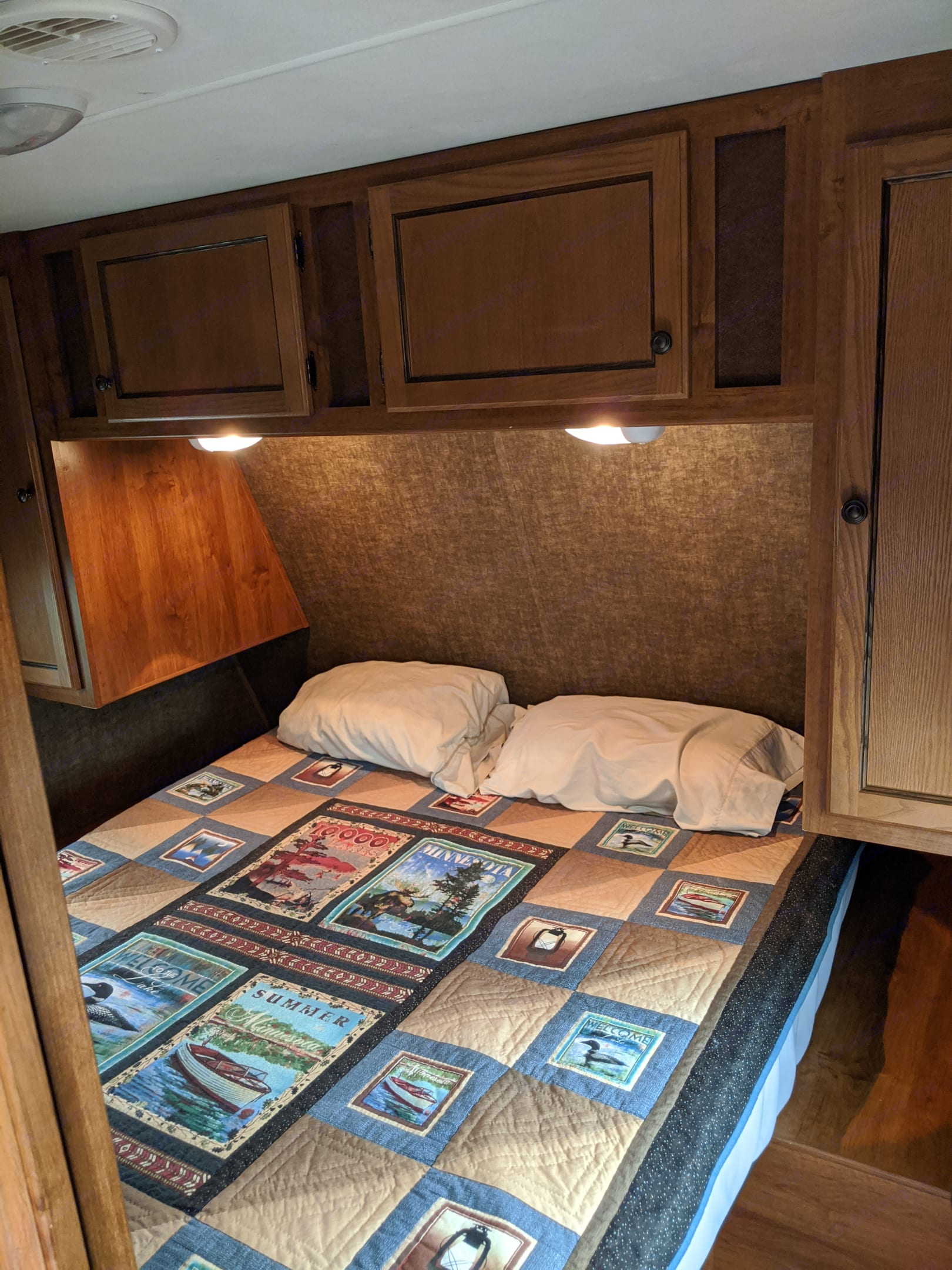 Front of the camper - master room. Queen bed with nice storage. TV swivels from family room into this room. Nice, quiet getaway room.. Heartland Trail Runner 2014