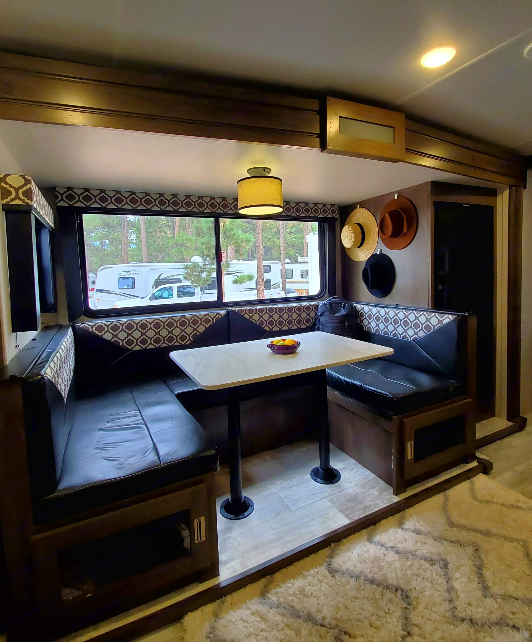 The Dinette converts to a sleeping area that can sleep 2 comfortably. We've also converted the area under the bench to hold 2 small pets.. Forest River Tracer 2021