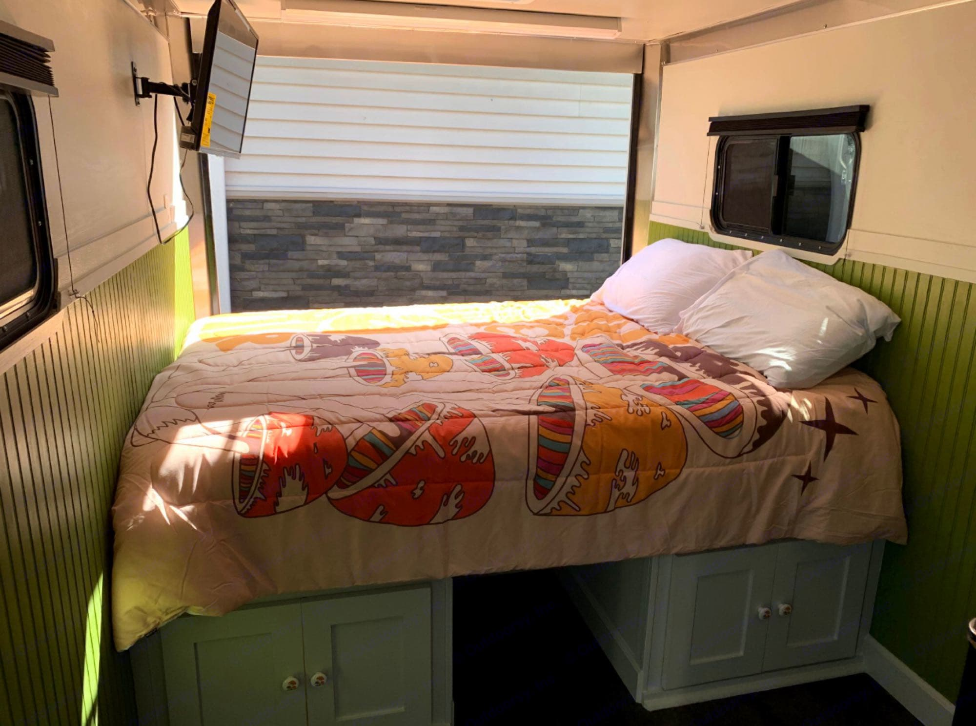 Storage underneath with cabinet doors inside and open access in back. Space in middle of cabinet doors is perfect for your furry family member!. Arising Trailer 2018