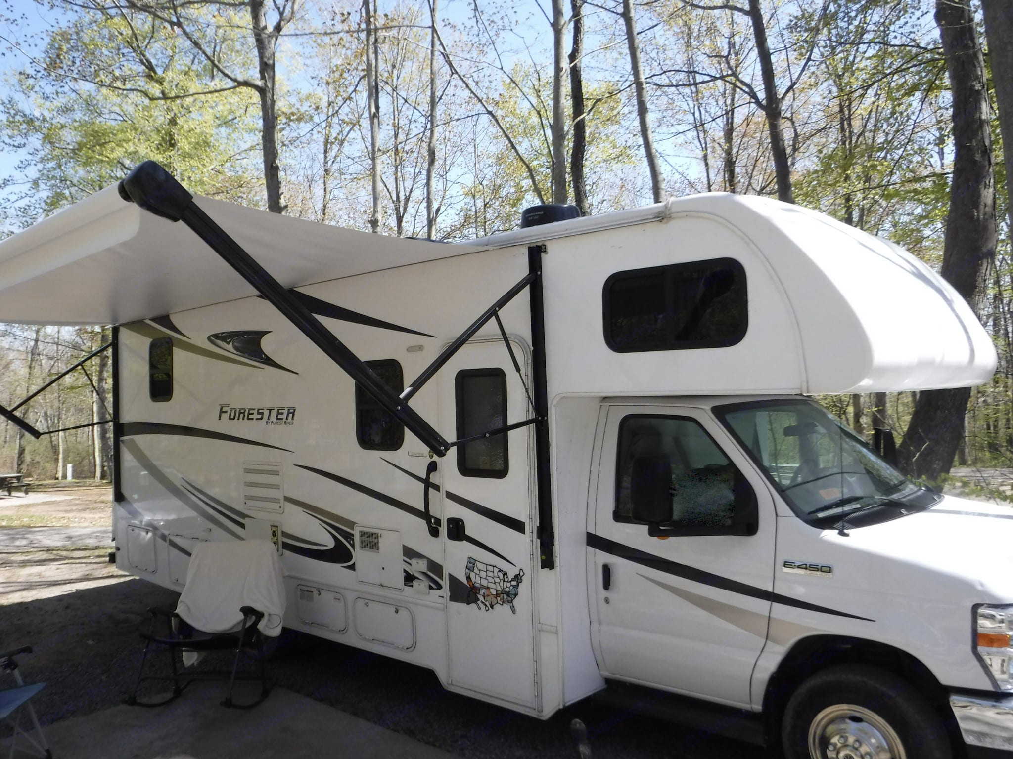 """Awning fully extended with the """"smart arm"""" awning technology.. Forest River Forester 2020"""