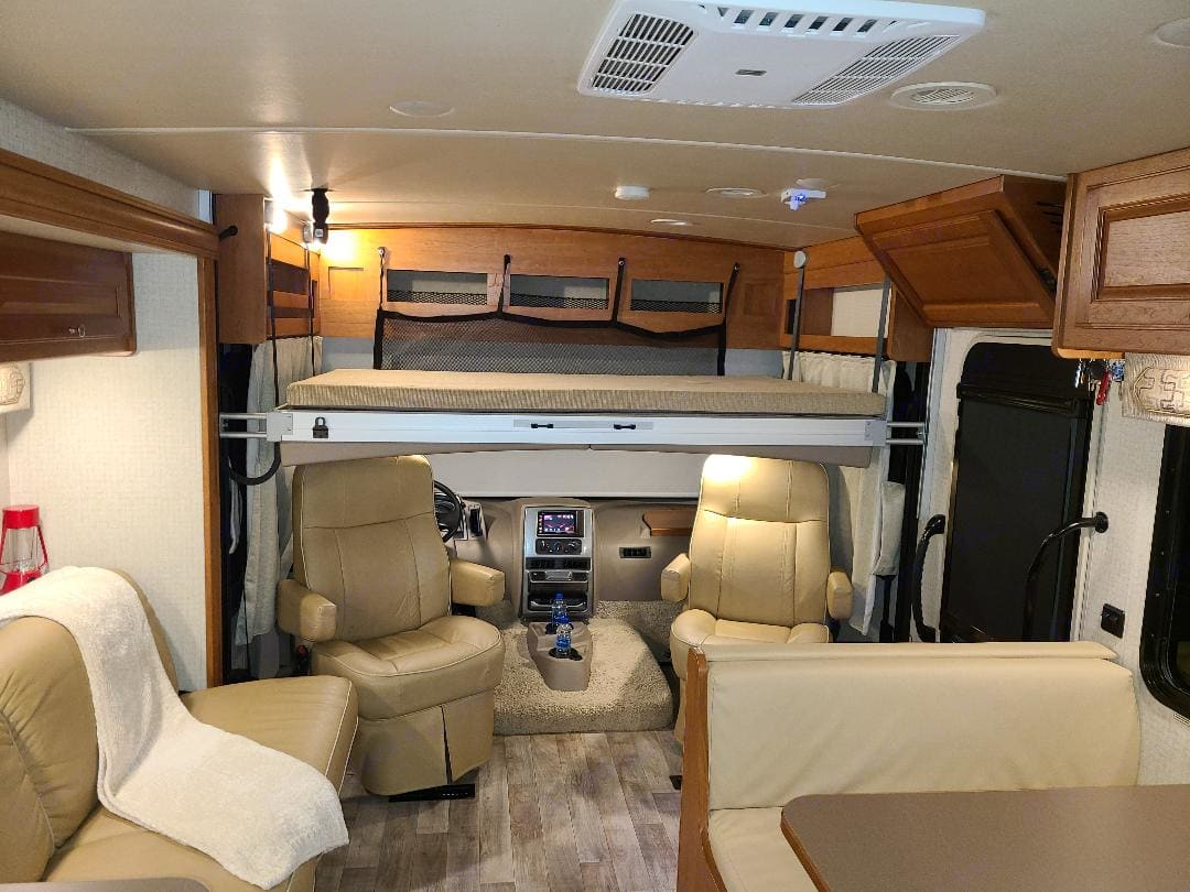 Motorized drop down loft adds additional full sized sleeping space. Easy access with ladder.. Winnebago Sunstar VE 2017