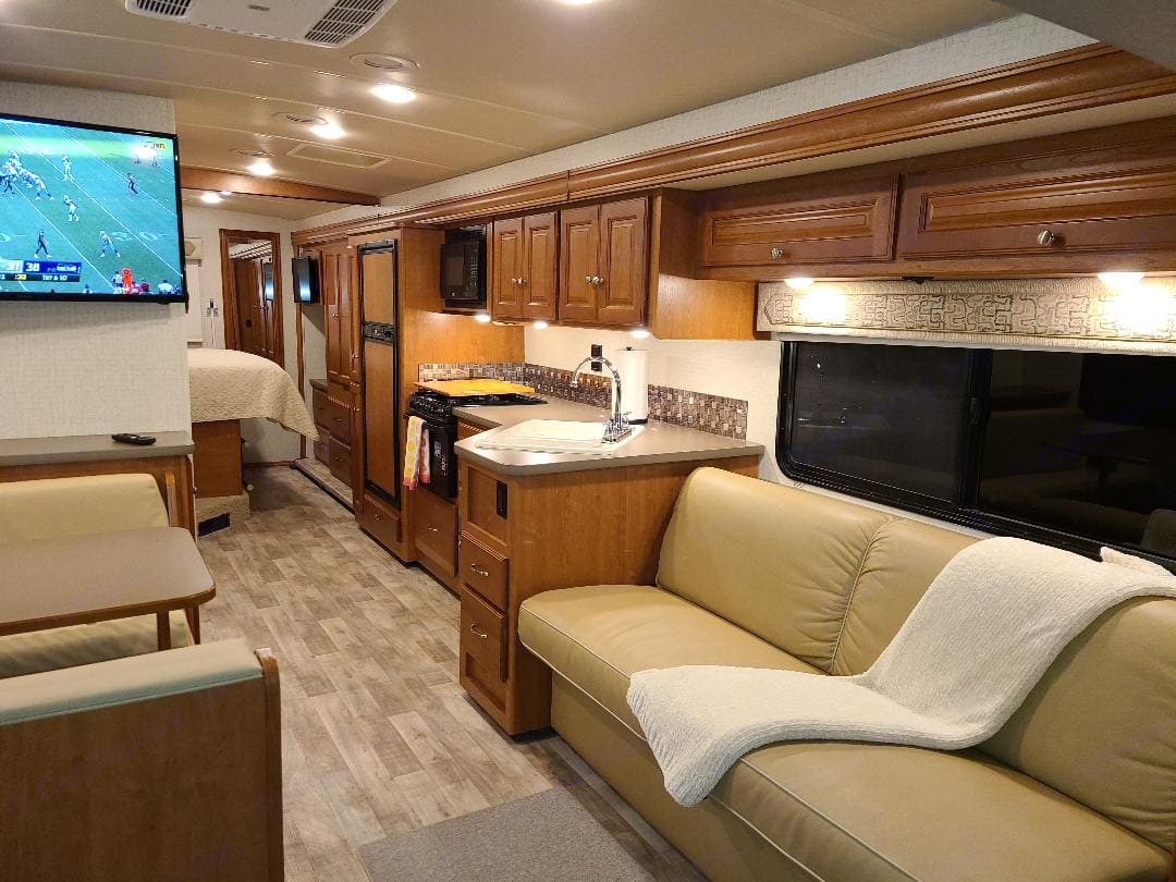 This well-designed layout features open walkways, functional kitchen with good counterspace, and tons of storage.. Winnebago Sunstar VE 2017