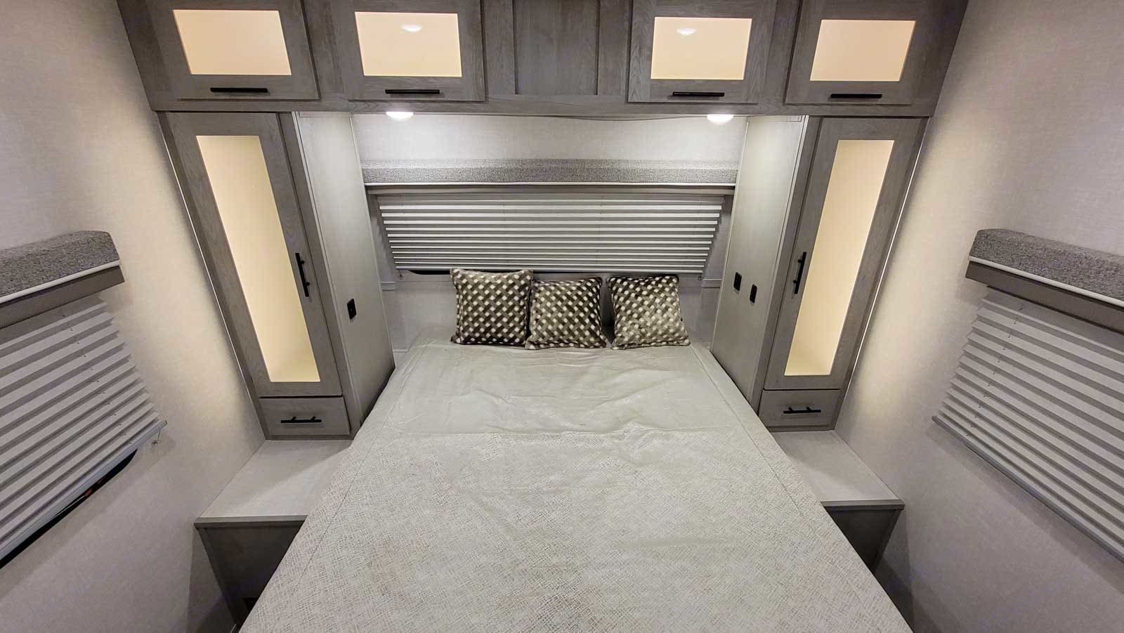 The bedroom is luxurious with separate closets, natural light, USB ports, and hidden platform behind the closets for your book, phone, water.. Forest River Ibex 23RLDS 2021