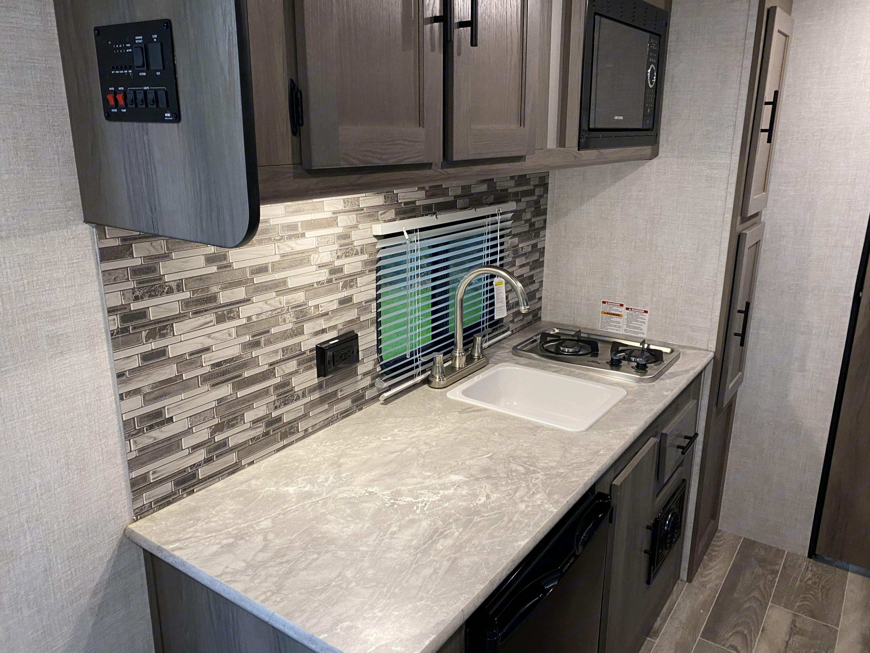There's plenty of space to prep dinner, and keep appliances like a coffee maker handy!. Gulf Stream Amerilite 2021