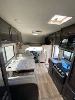 Full bed over cab and large TV that swings out. Thor Motor Coach Four Winds 2020