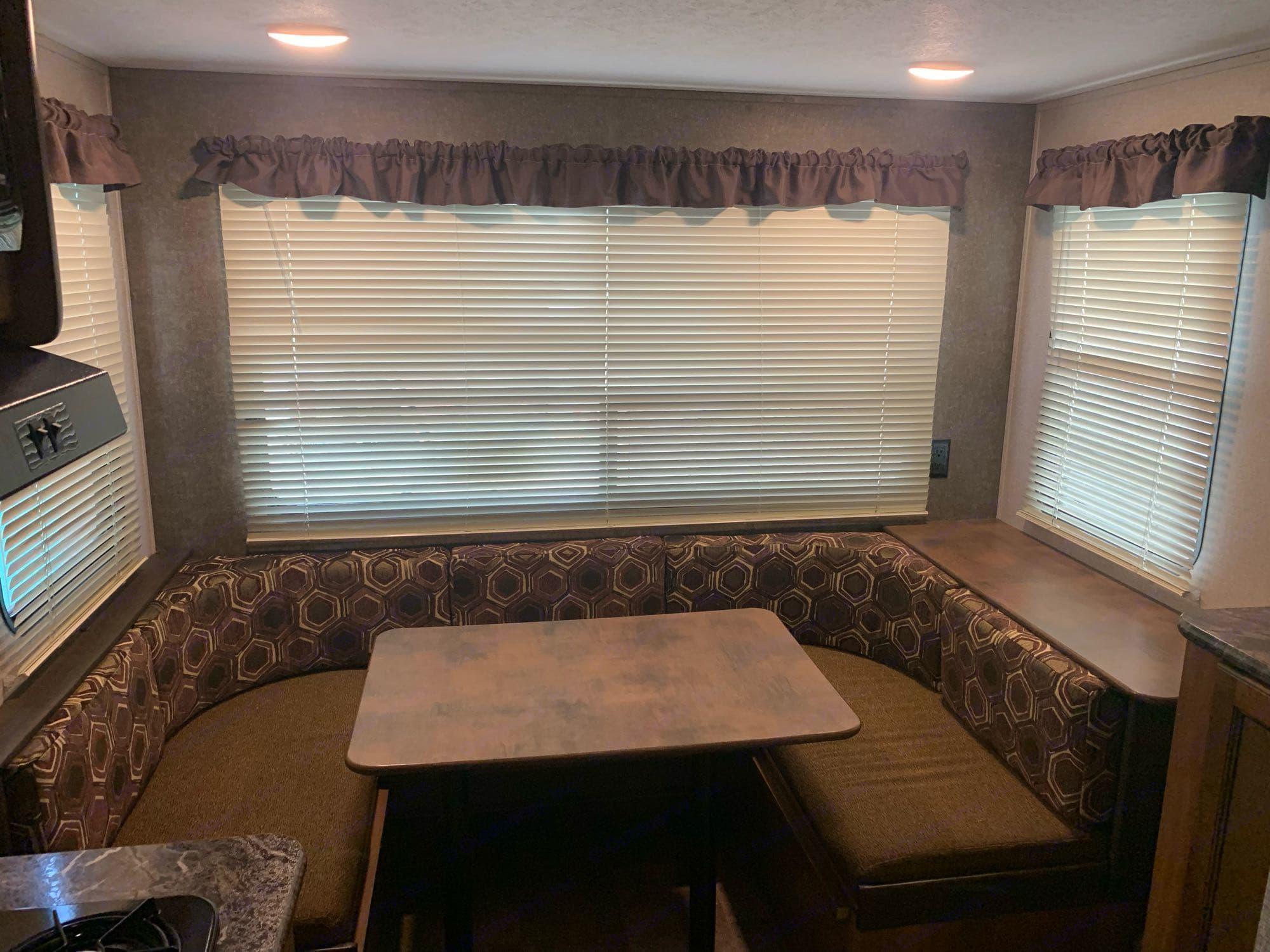 Big U shaped dinette with large windows!. Keystone Springdale 2018