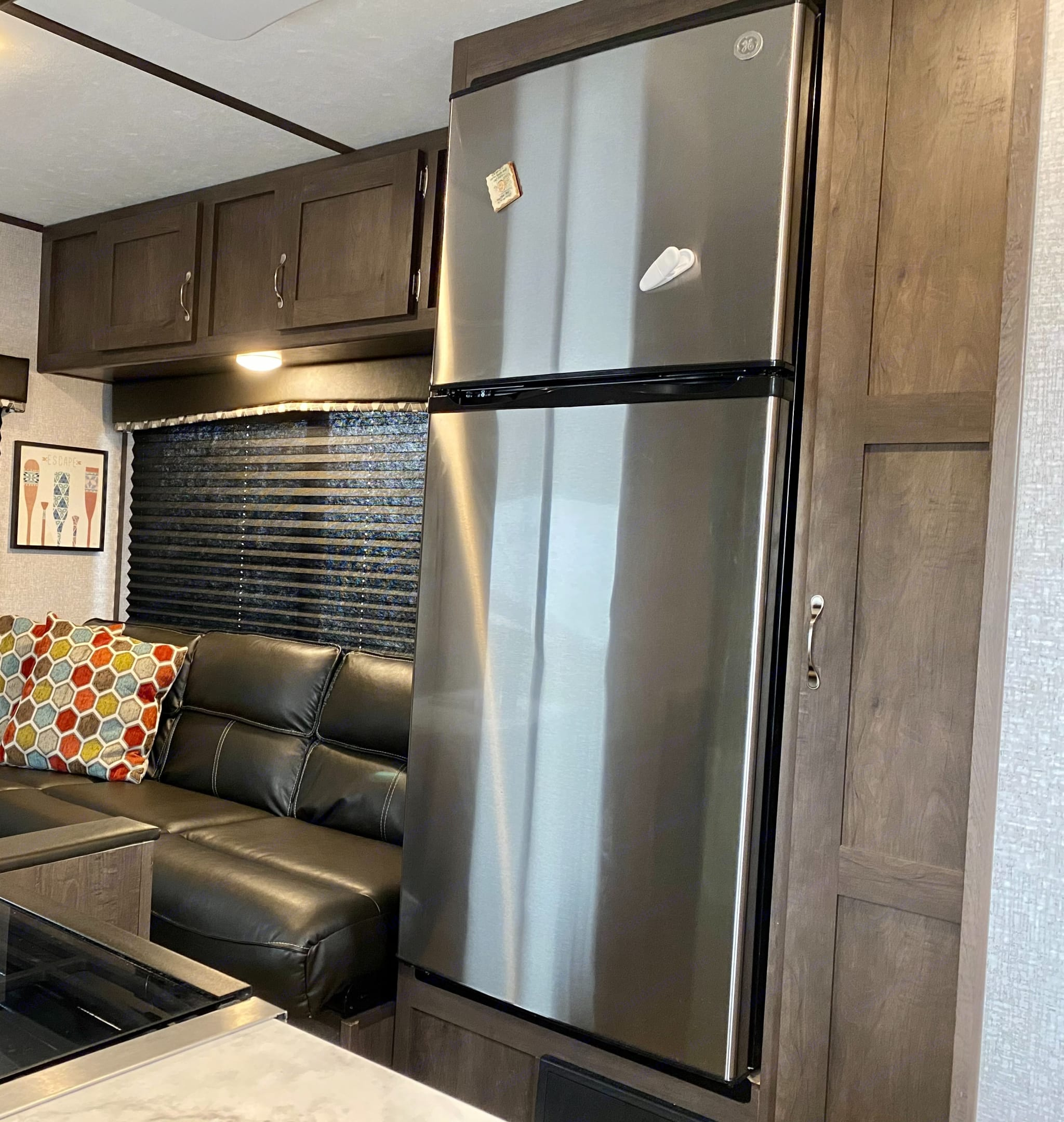 The 12V fridge 7 cu.ft. and spacious pantry make cooking away from home easy. . Dutchmen Coleman 2021