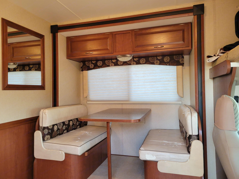 4 Seat dining with storage under the seats. . Winnebago Minnie Winnie 2015
