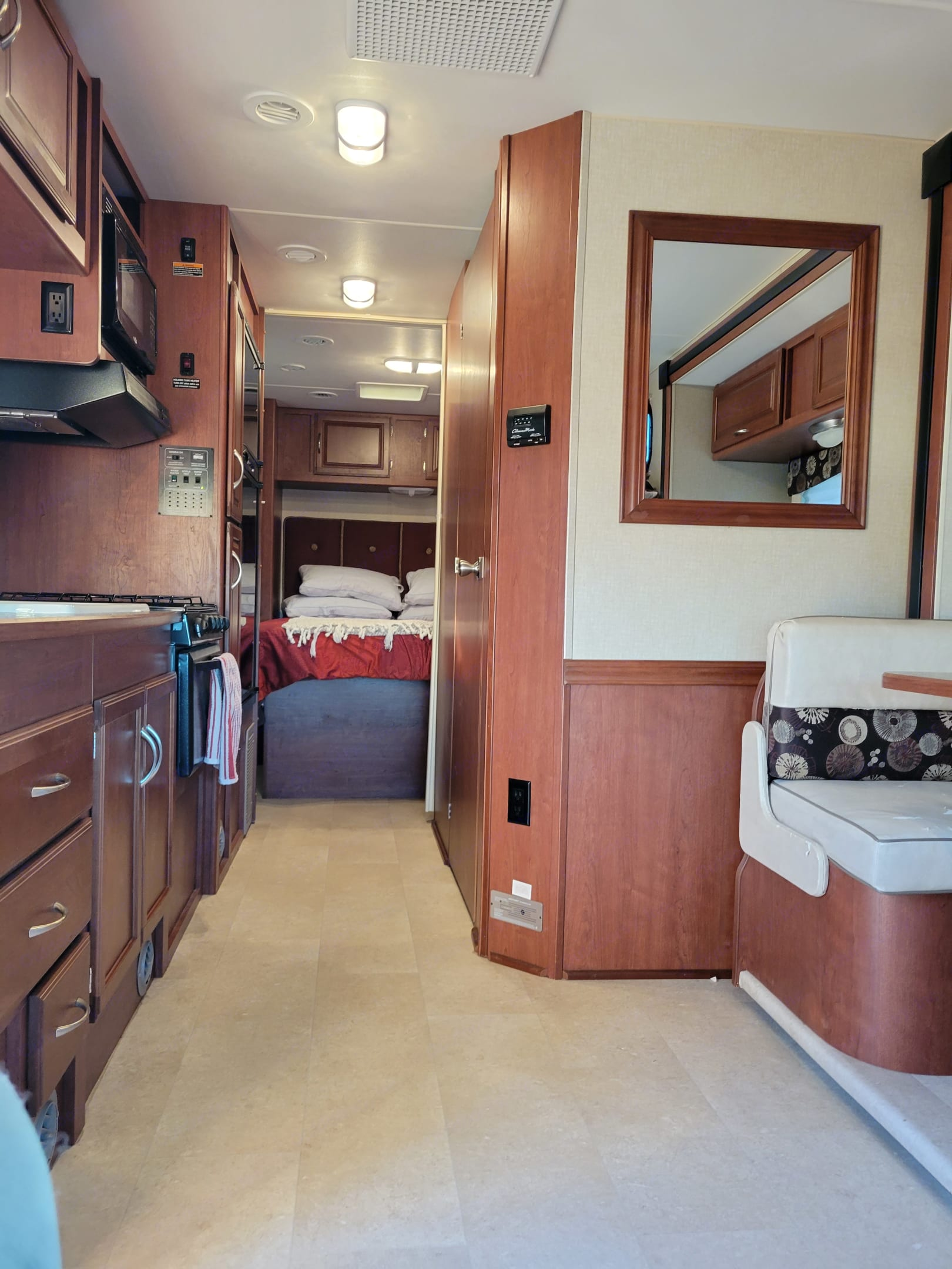 View of the bedroom from the front of the RV.  Dinette has a slide out for additional space. . Winnebago Minnie Winnie 2015