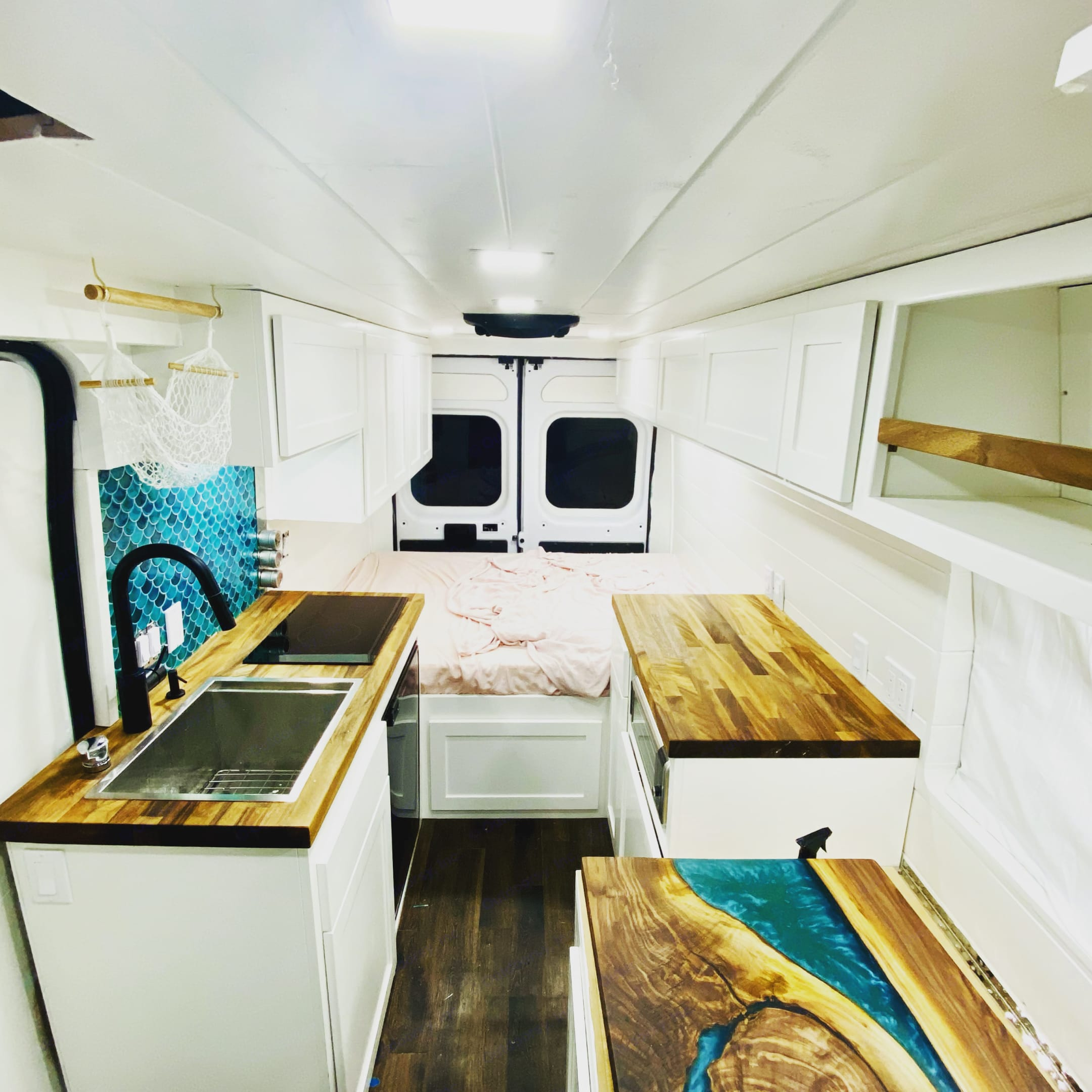 This is another view from behind the cab. Sliding door is on the left and the couch and window is on the right.. Dodge Other 2019