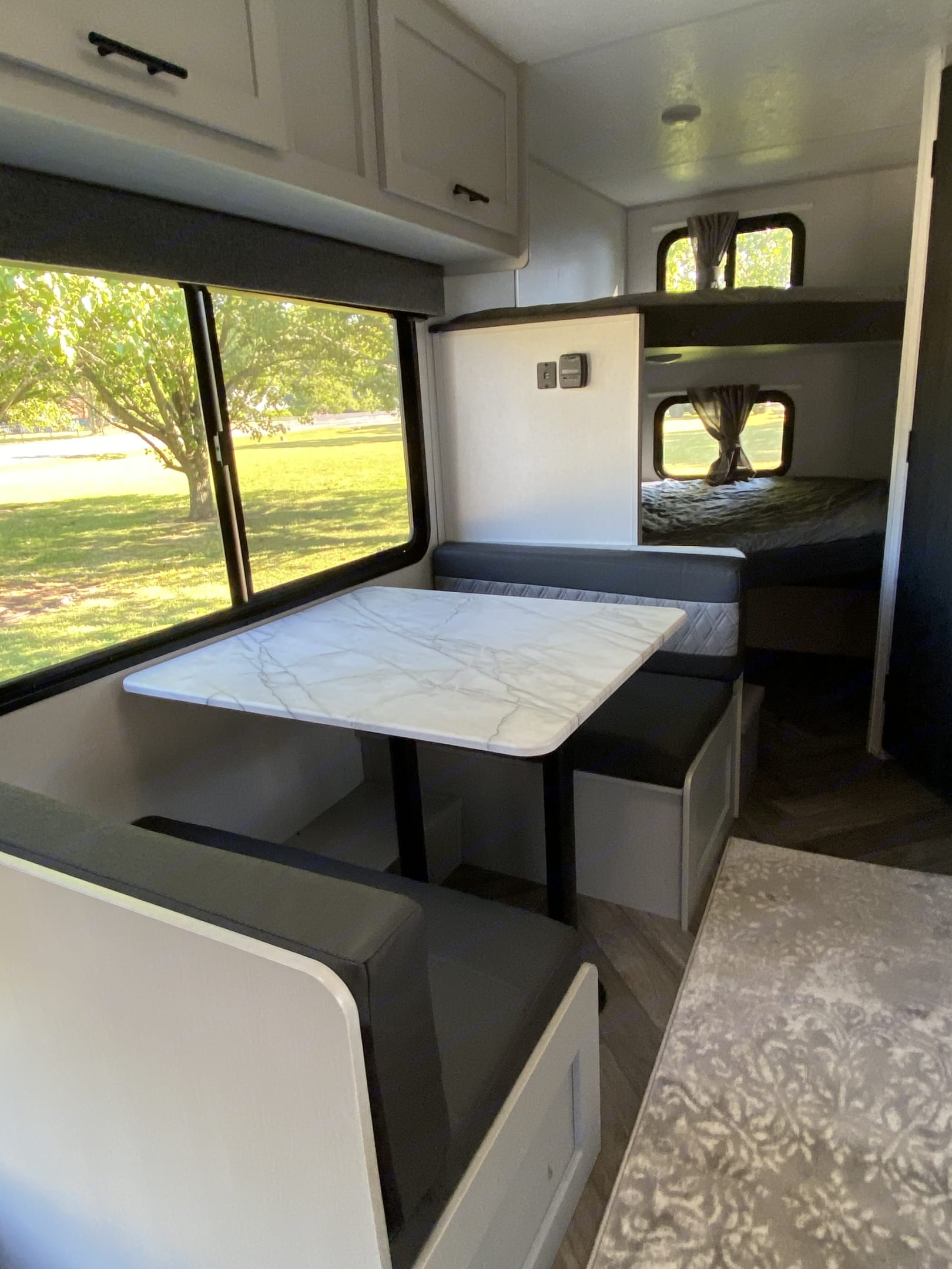 Dinette that converts to a bed! With a view of the large double bunks.. Forest River Salem 2021