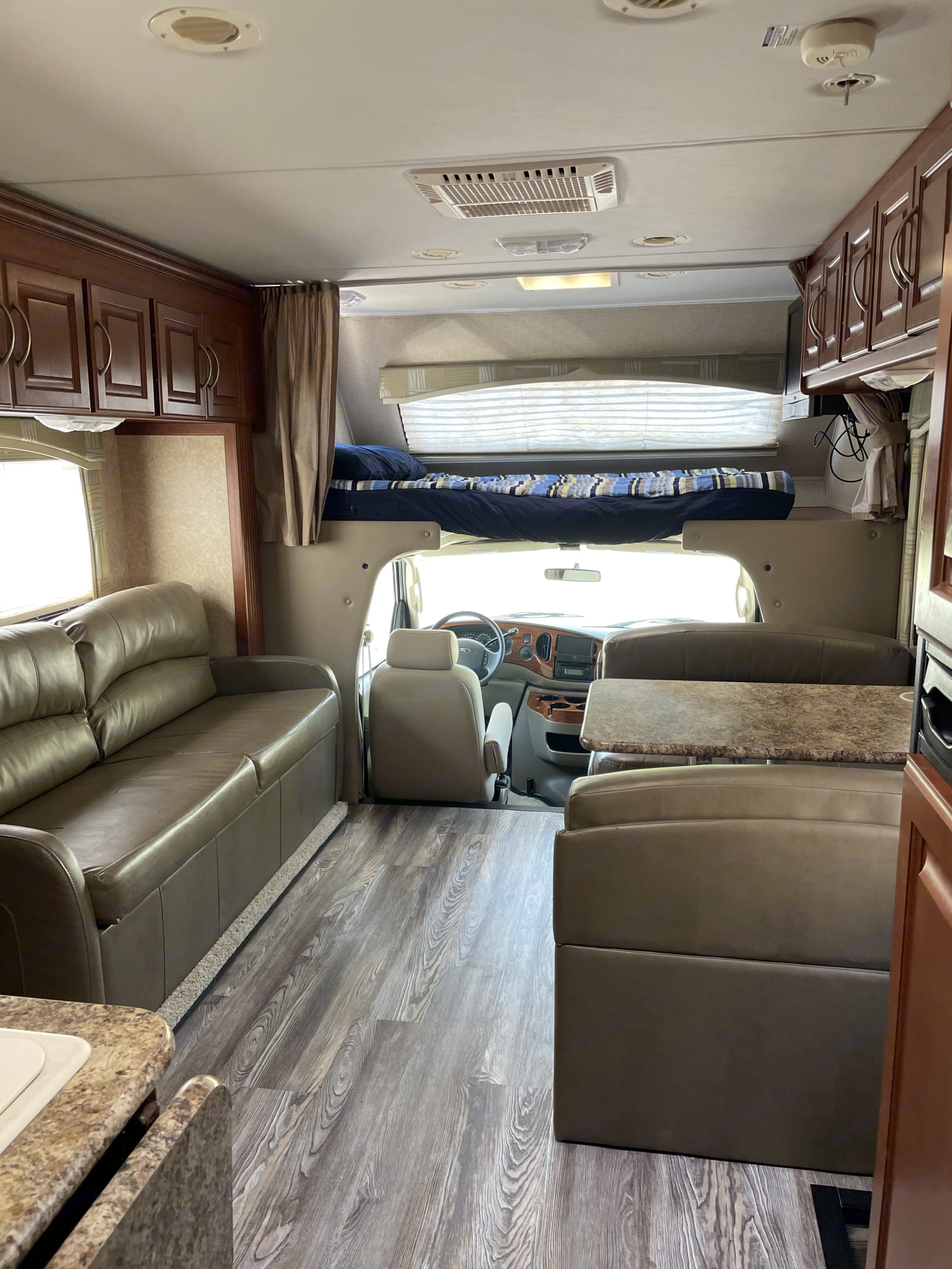 View with the popout. Queen bed above the cab.. Thor Motor Coach Chateau 2010