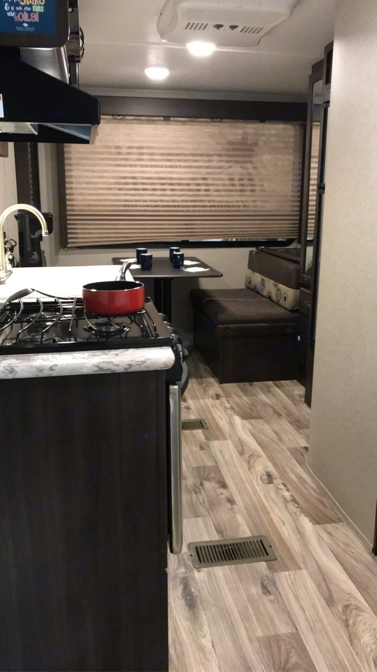 From entrance door looking into the trailer showing kitchen and dinette. Springdale 179 QBWE 2018