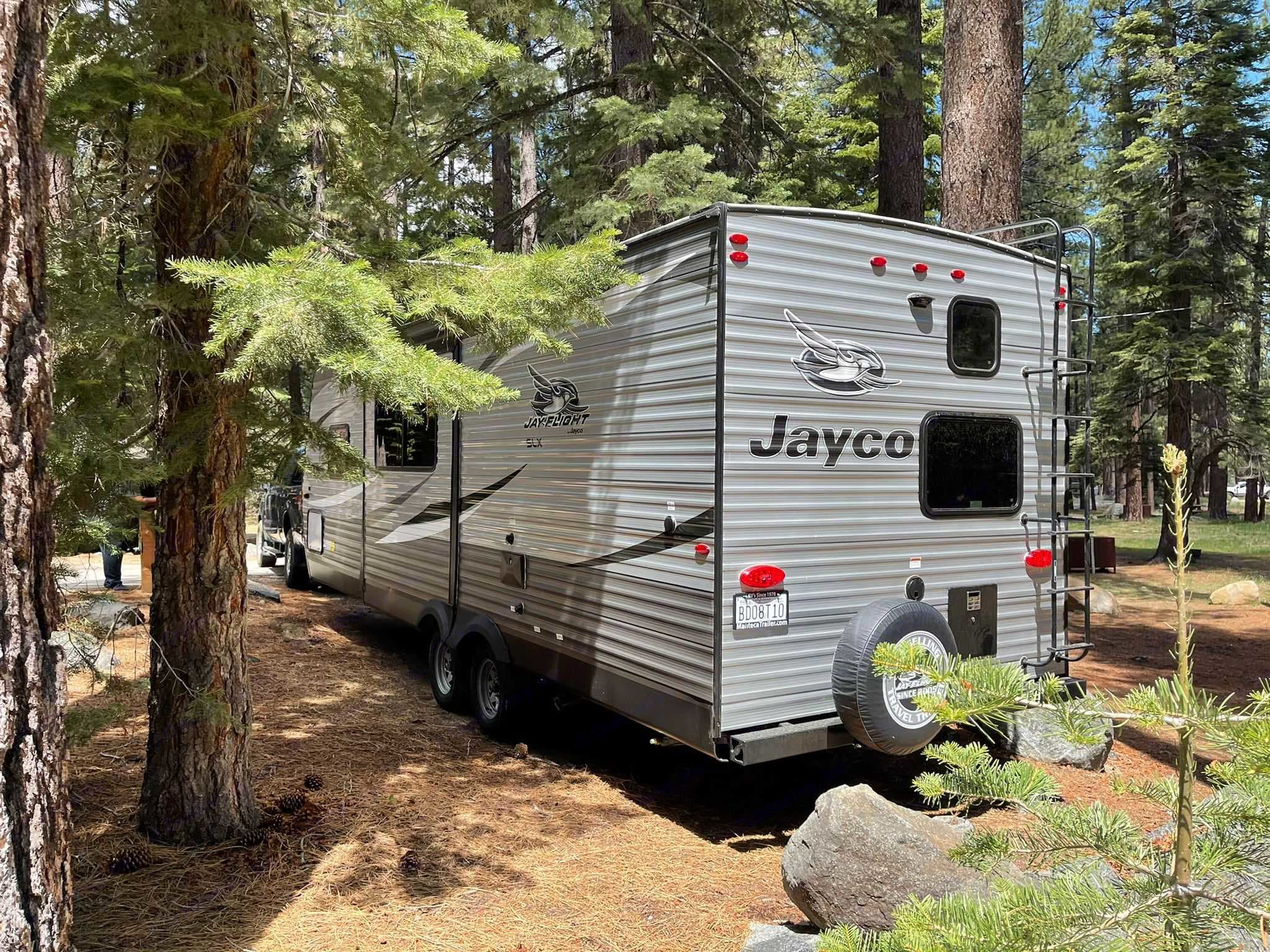Spare tire and ladder on back of trailer . Jayco Jay Flight 2021
