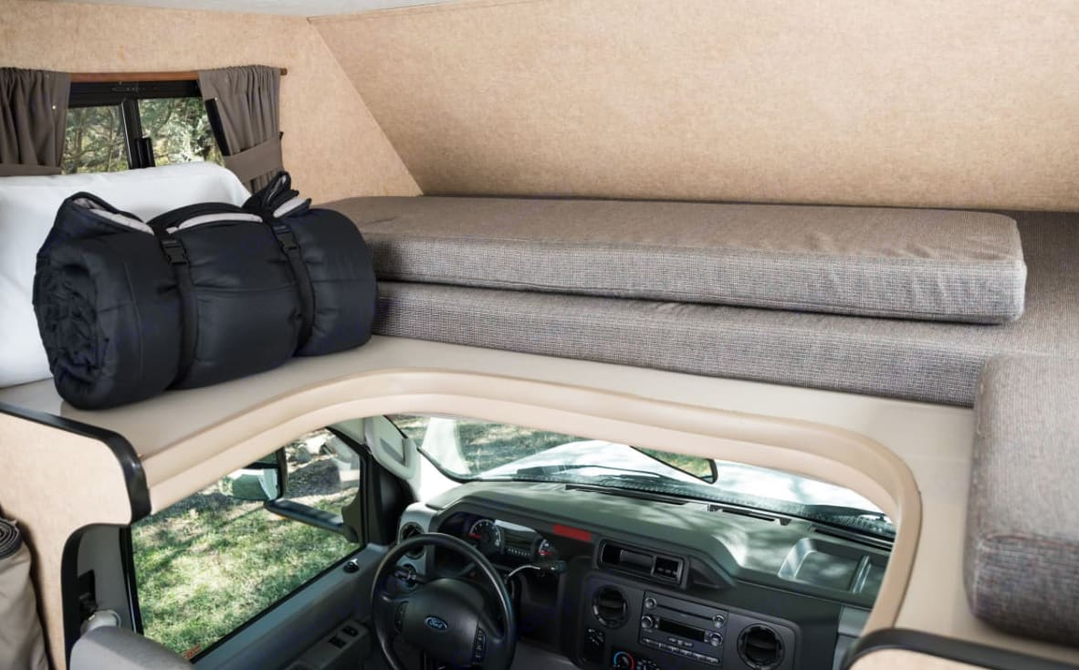 The bed is easily stacked for more head space while driving.. Majestic Leisure Craft Econoline 2016