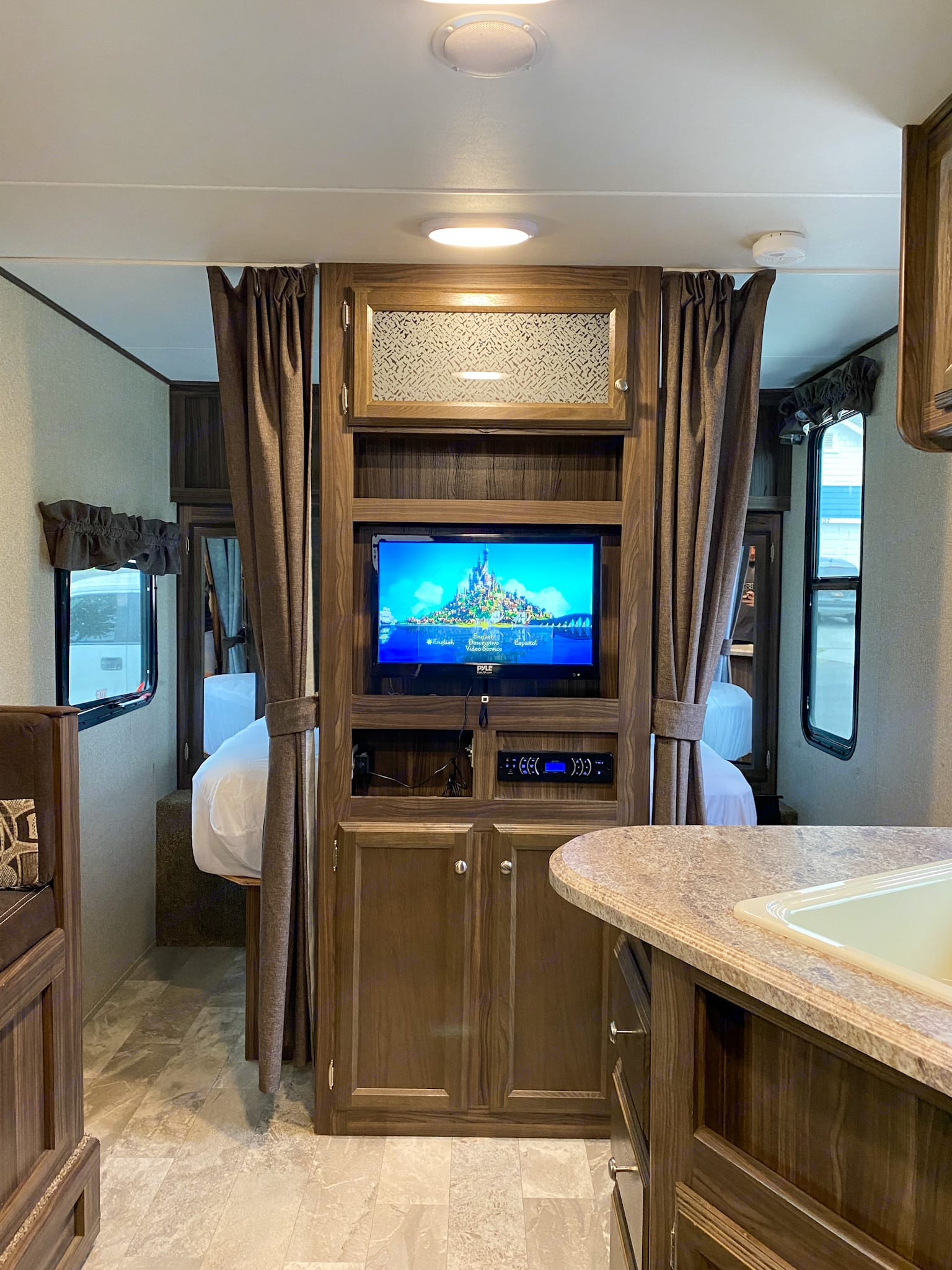 Entertainment center includes pull out tv, dvd, bluetooth, and radio. Includes interior and exterior speakers.. Coachmen Other 2018
