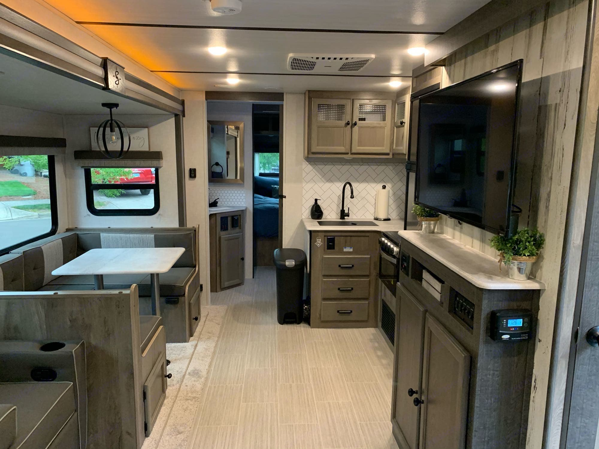 Kitchen area and U-shaped dinette.  Dinette will fit four adults easily.. Forest River Surveyor Legend 2021