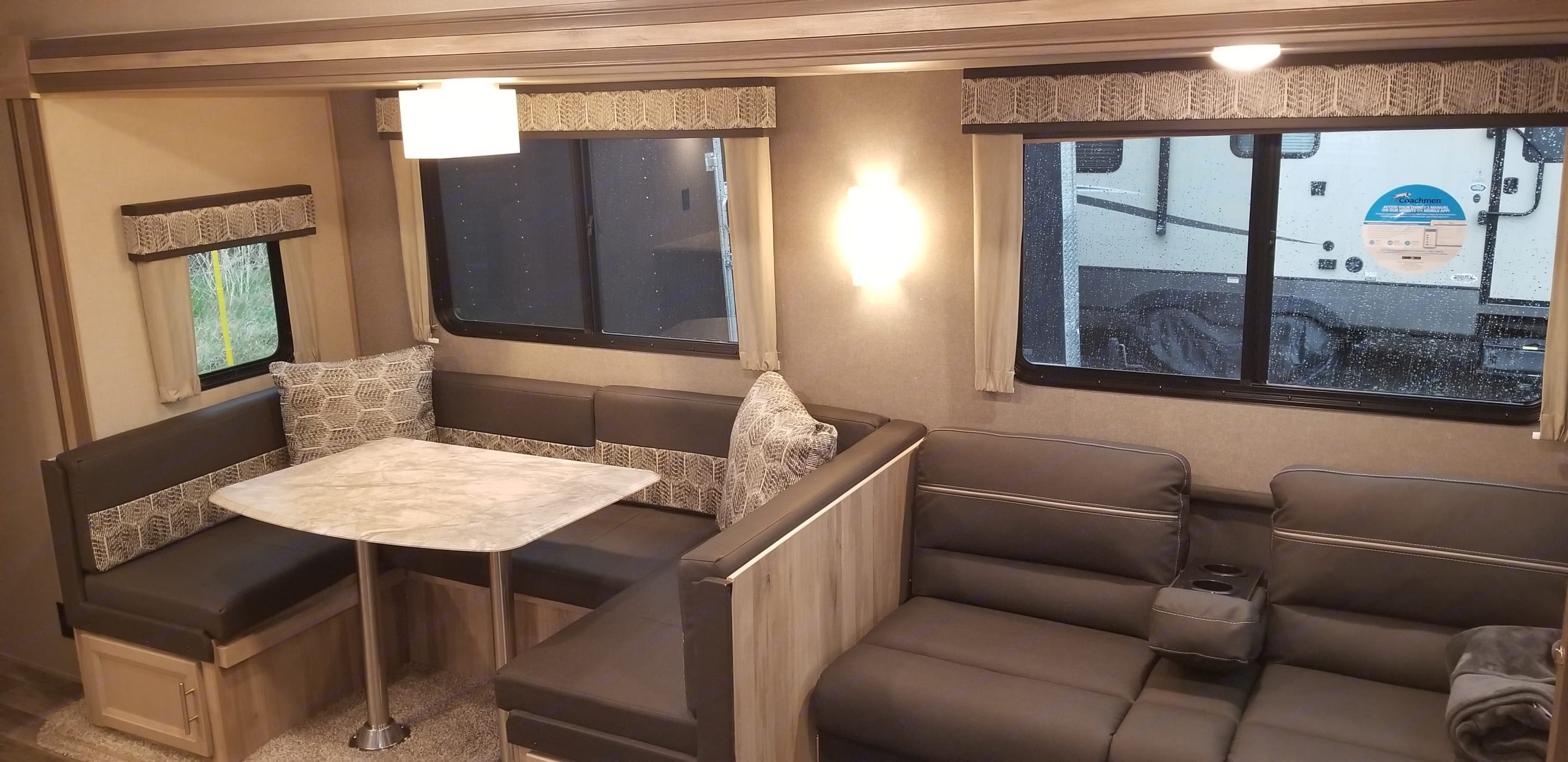 convertible dinette and couch fold into extra beds, large storage under dinette. Forest River Catalina 2021