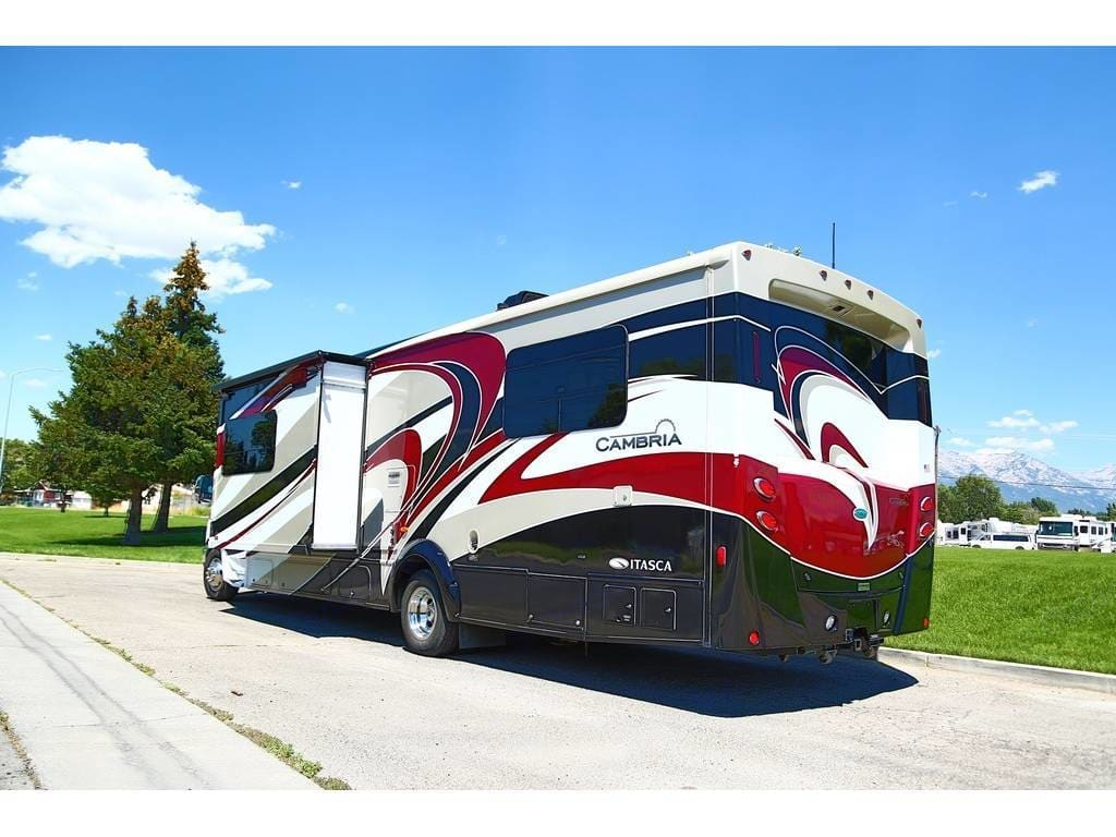 Huge storage in the rear. Lift up lid. Two storage compartments underneath. One slide out on the driver's side. . Itasca Cambria 2014