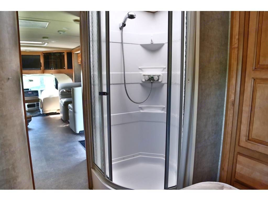 Private commode/lavatory with a Door that opens to provide a huge private dressing room. Instant hot water.. Itasca Cambria 2014