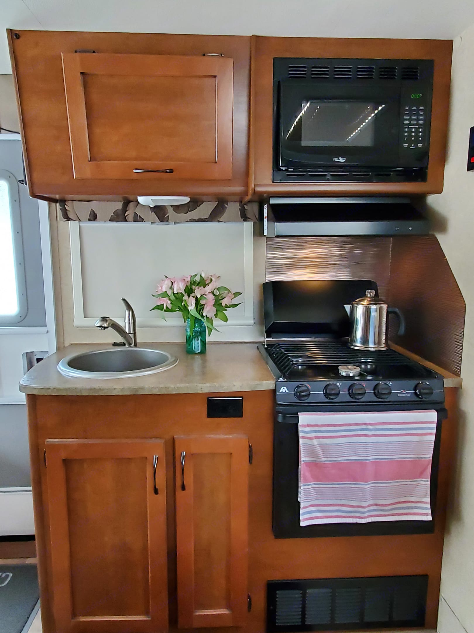 This may be compact, but all appliances are of generous size, easy to use and easy to clean. Good under and above counter storage too.  . Lance 1575 2016