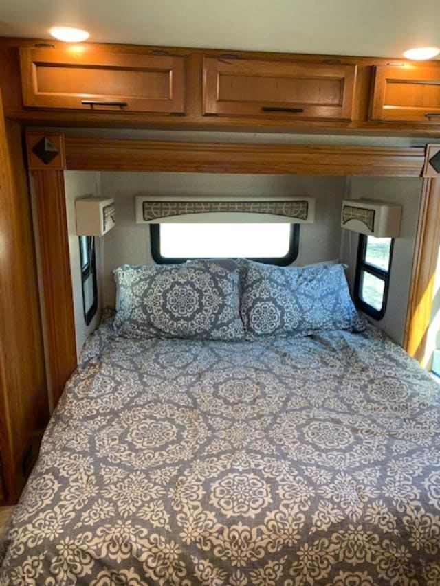 Queen size bed is located in a slide-out at the rear of the RV. Jayco Melbourne 2016