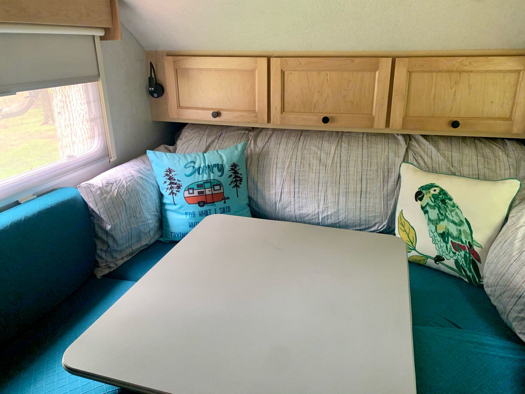 """Converts to an oversized queen bed. 3"""" memory foam topper rolled up under cabinets included w/ duvet cover already on, so makes up in to a bed easily. T@B T16 2008"""