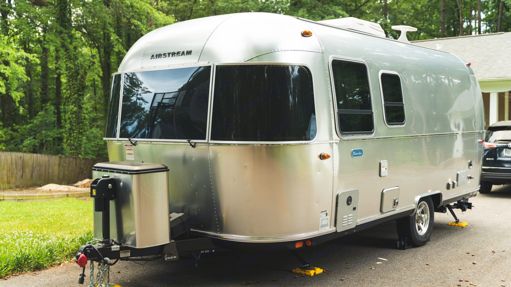 Dual 25 pound propane tanks and tinted rock guards for the front windows.. Airstream Bambi 2021