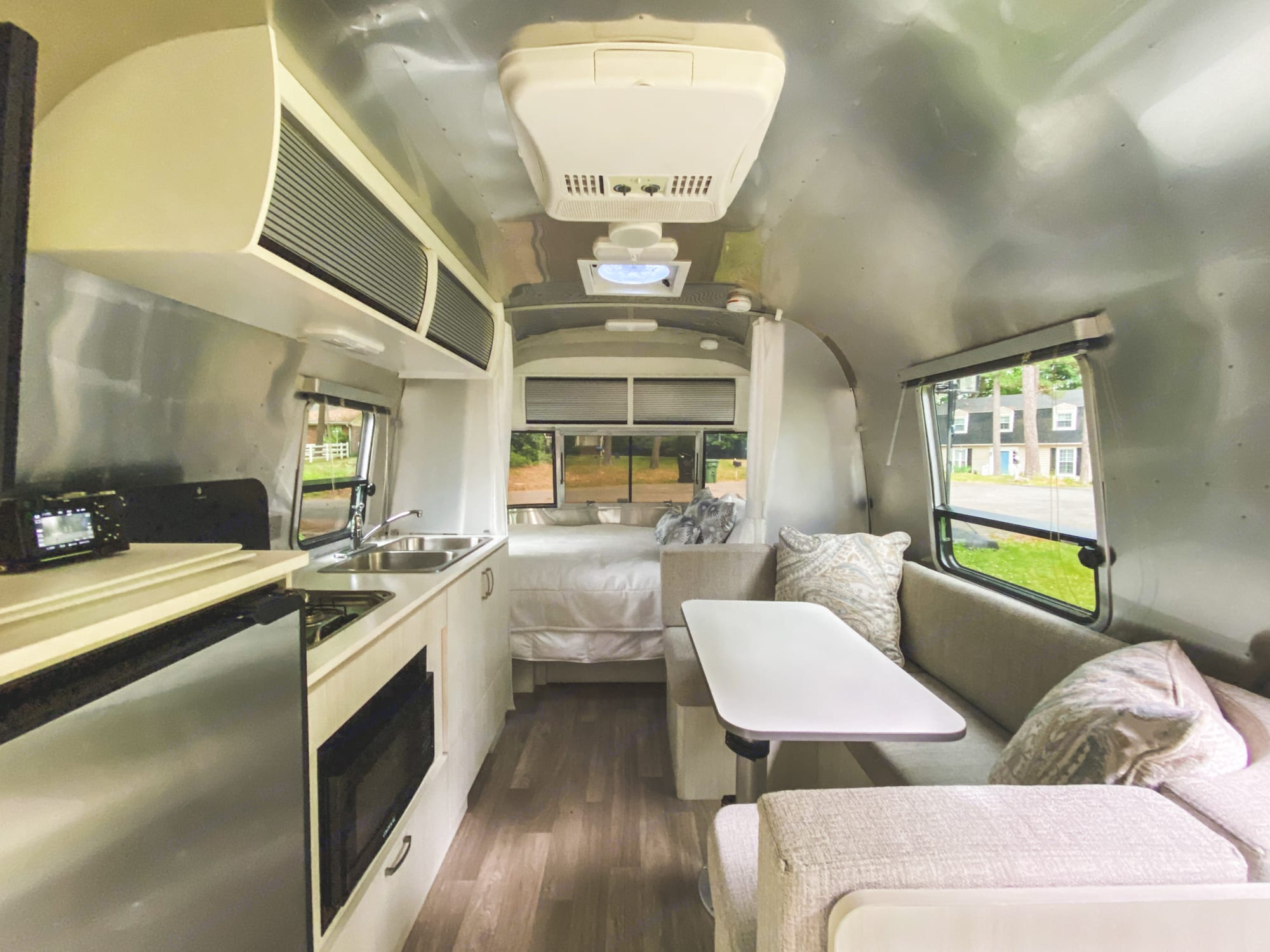 This is a shot standing at the rear of the Airstream, looking toward the main bedroom at the front of the trailer.. Airstream Bambi 2021
