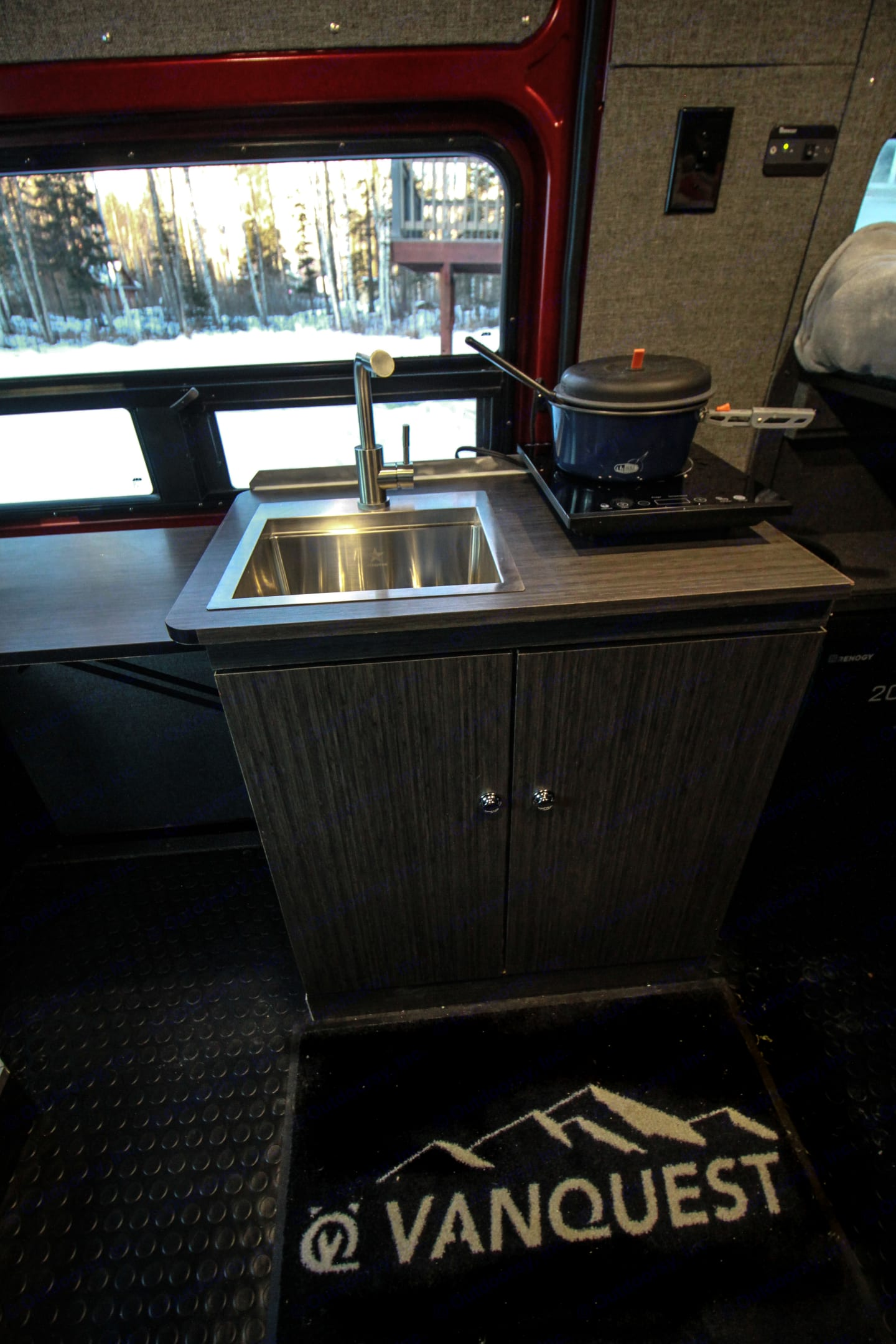 Kitchen with sink, cooktop, and extendable counter space!. Yetti Vanquest 2020