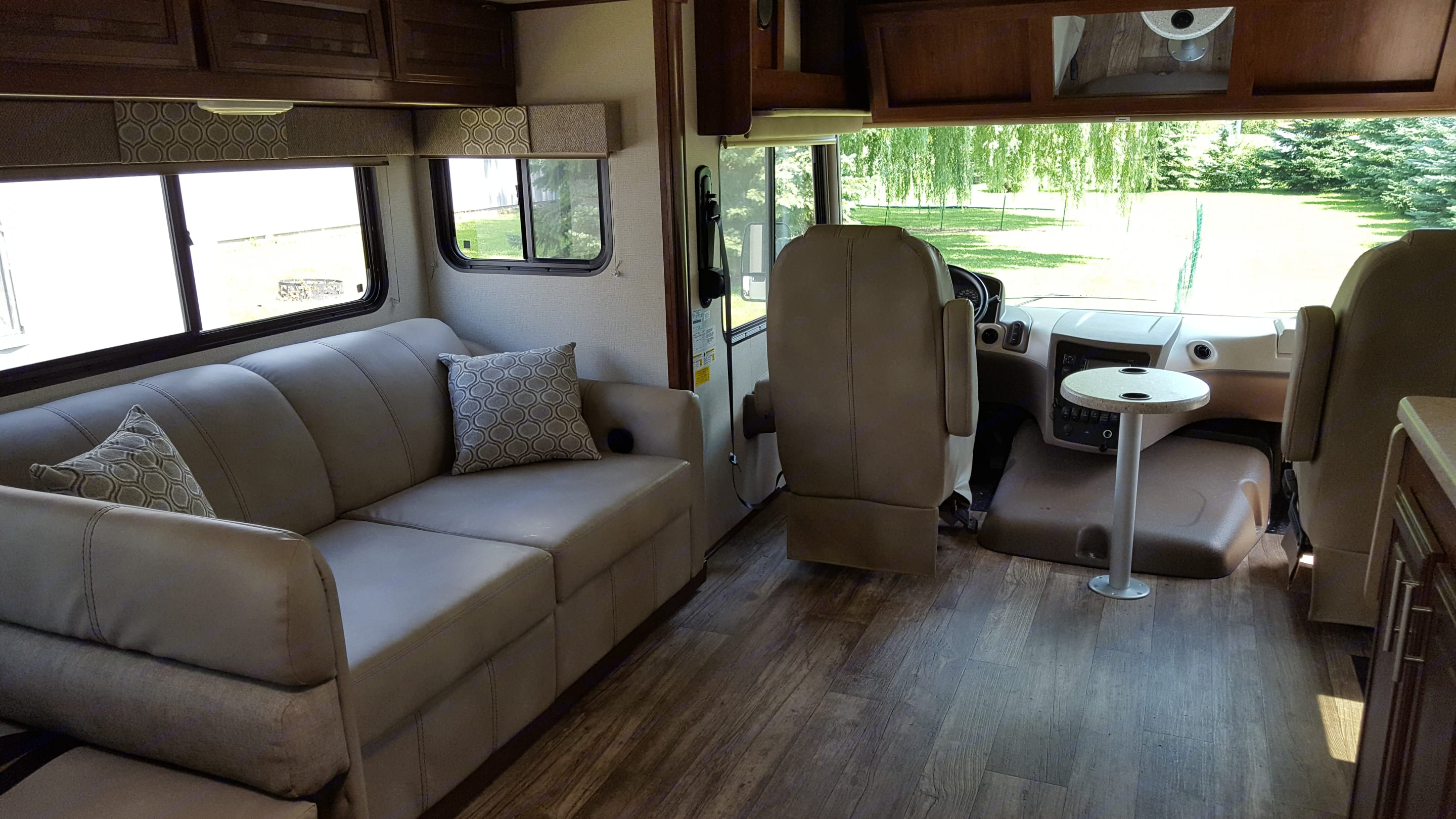 Inside of RV with slide out. Pull out sleeper sofa and drivers seat. Flush Floor Construction (no steps into cockpit). Forest River FR3 2018