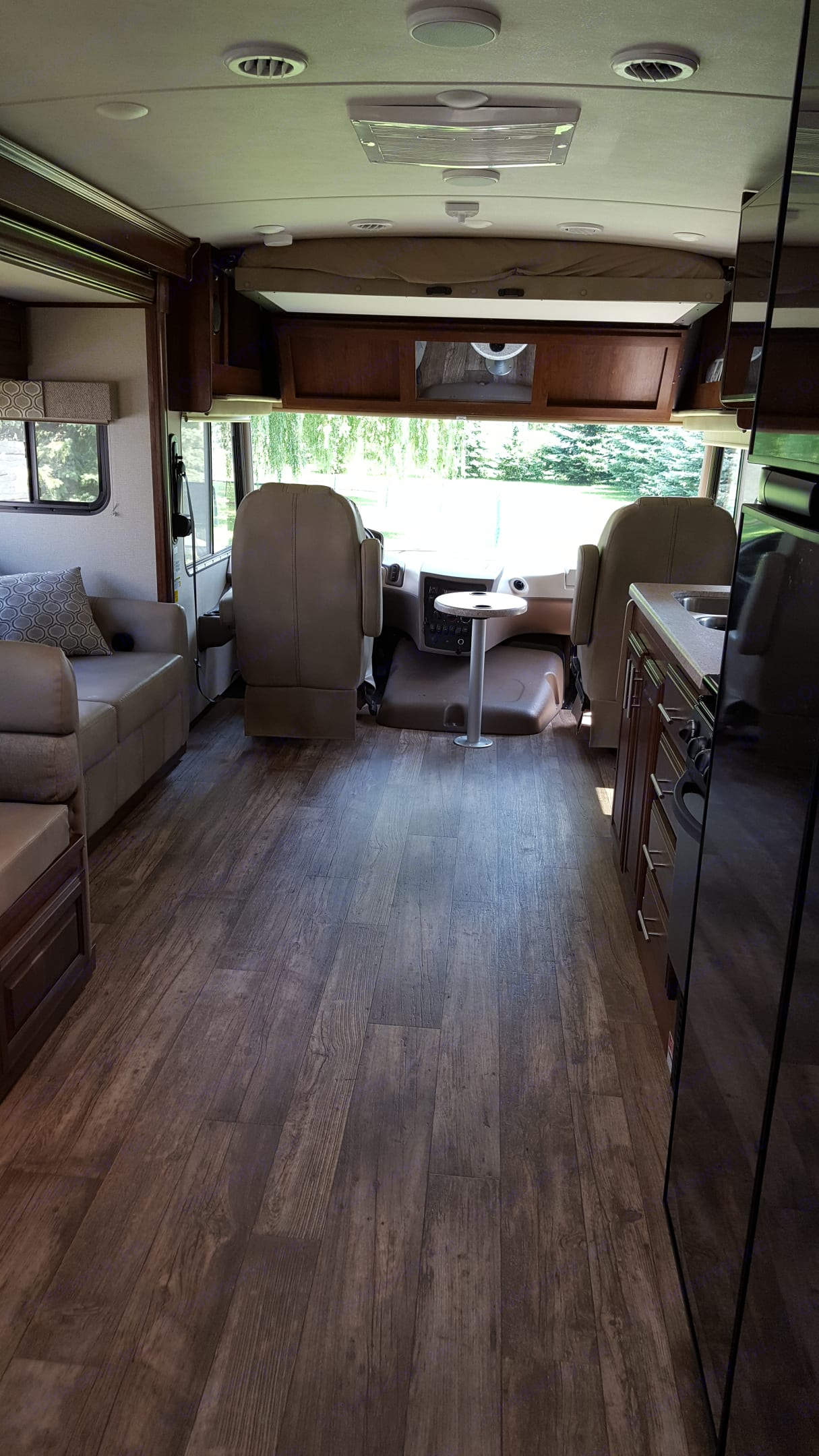 Large comfortable driver and passenger seat with table in between. Captain chairs swivel around to be used as extra seating in living room.. Forest River FR3 2018