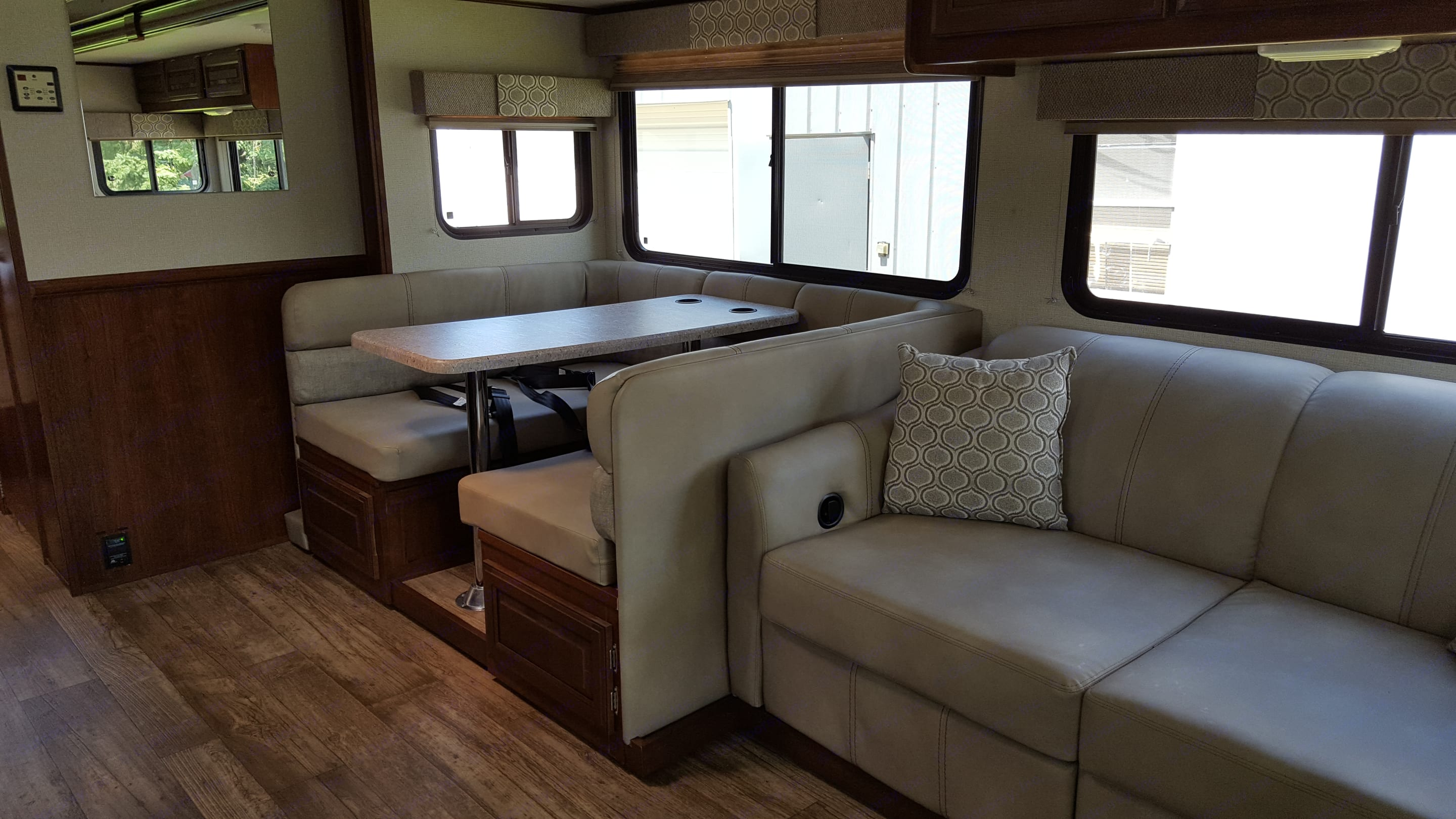 Dinette seats 4 people and has 4 seatbelts. Also folds down for sleeping. Pull out hide-a-bed sofa sleeper has foot recliners.. Forest River FR3 2018