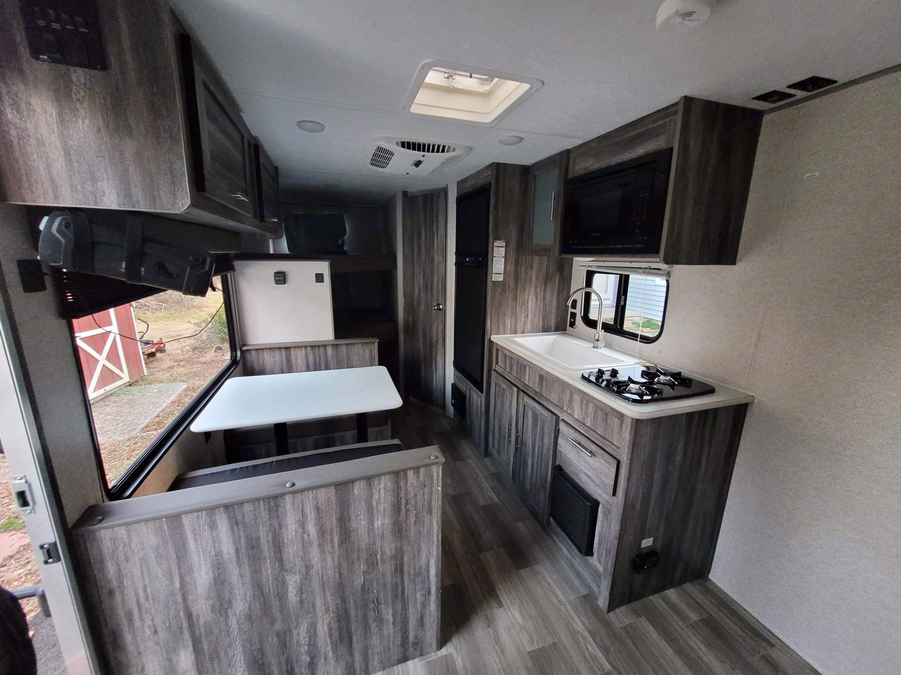 View from the door toward the back of the RV with the bunks and bathroom.. Forest River Wildwood 2020