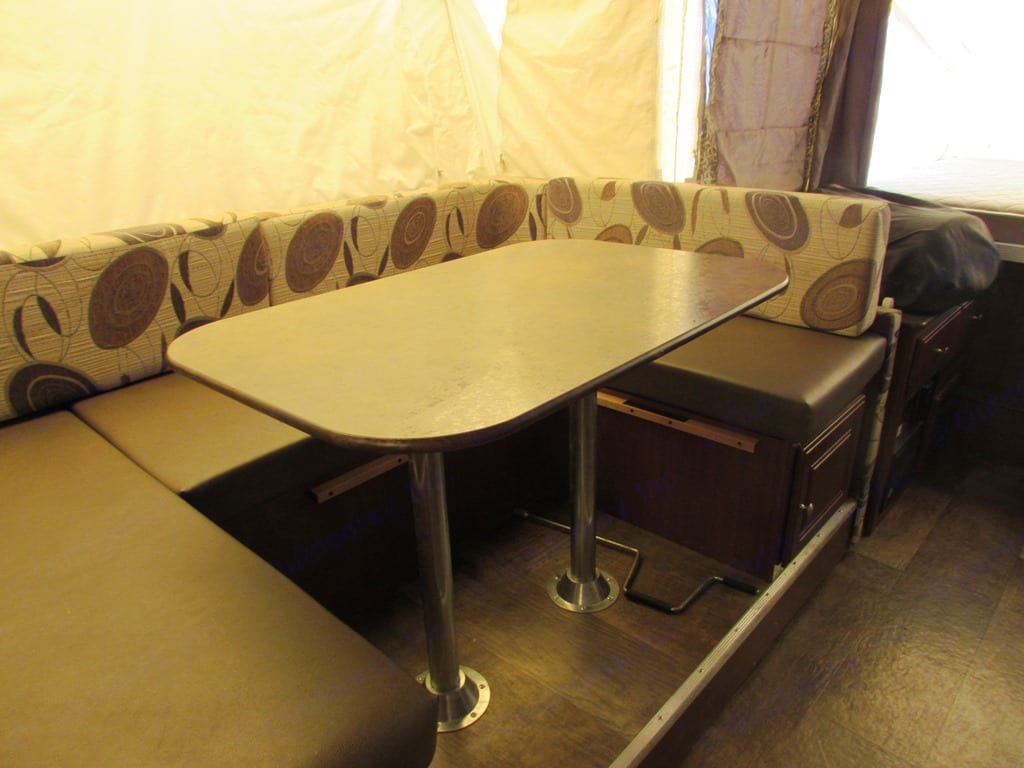Slide out dining table with storage under seats. Converts to bed.. Forest River Rockwood 2015