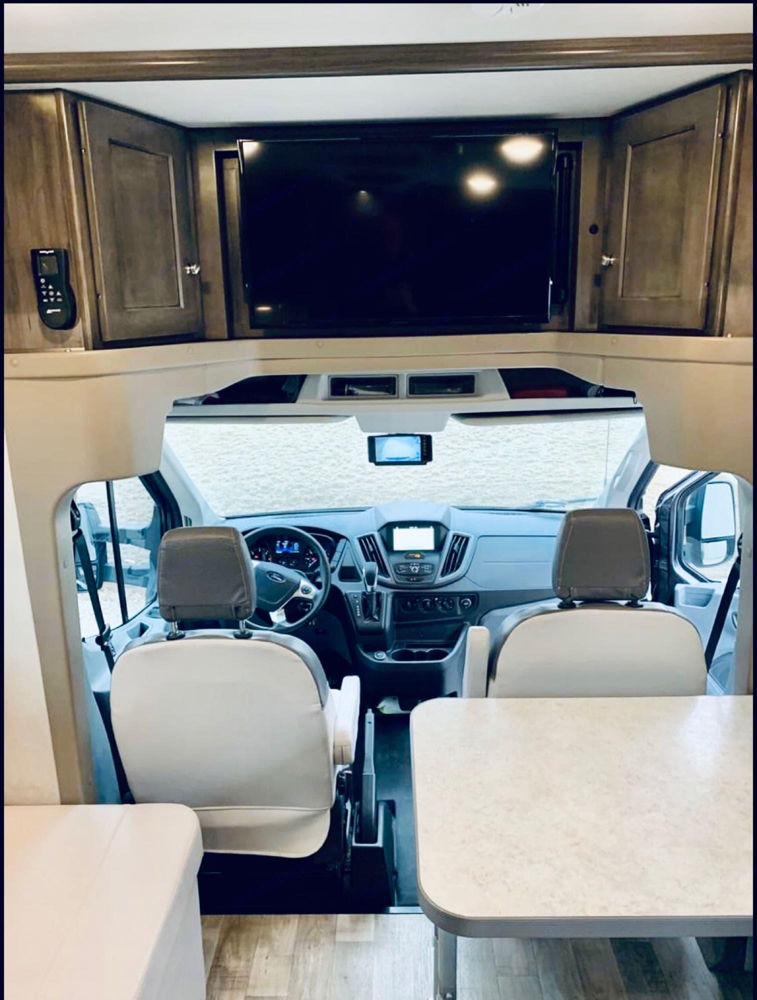 Passenger swivel to dinette seating. Entertainment system, and rearview camera. Satelitte/bluetooth capabilities. . Winnebago Ford Transit Winnebago Motorhome 2018